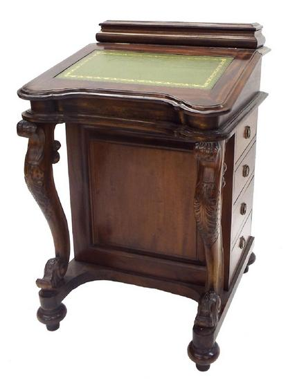 Antique style hardwood Davenport, the gilt tooled green leather top enclosing an interior fitted with eight serpentine small dra