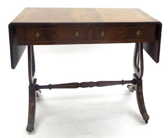 Regency style mahogany sofa table fitted with two short drawers and lyre supports