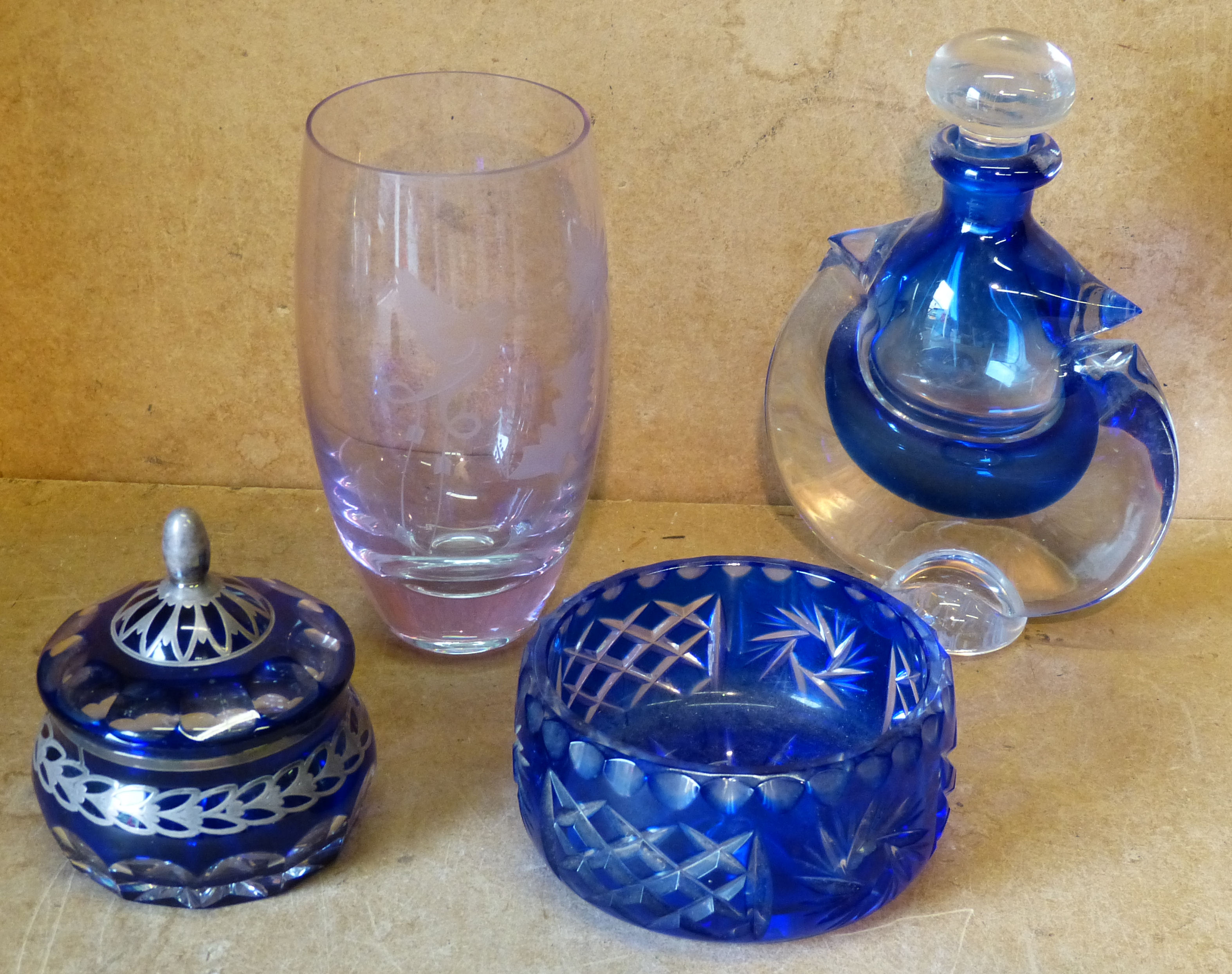 A Clear and Blue Glass Scent Bottle with stopper, a blue glass small round bowl