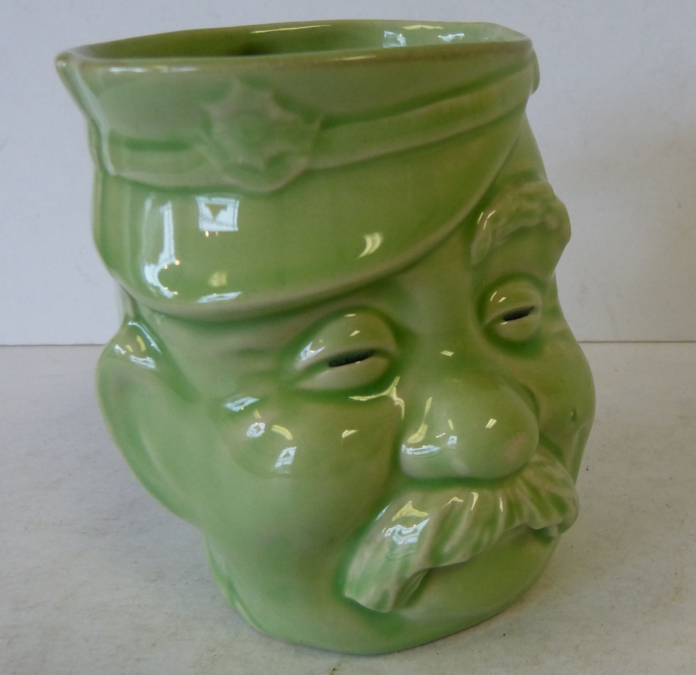 A China Character Jug ``Old Bill`` on green ground