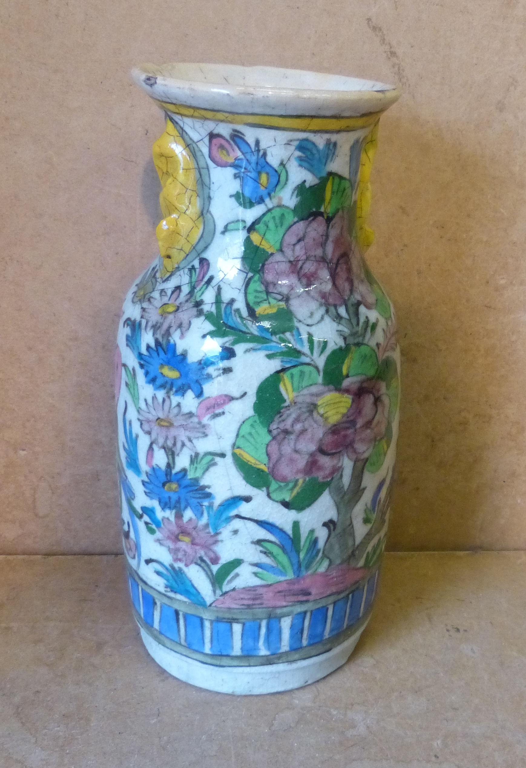 A Glazed Earthenware Bulbous Thin Neck Trumpet Shape Vase having multicoloured floral