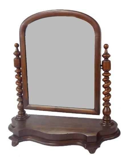 Victorian mahogany dressing mirror, the arched mirror upon barley twist columns and serpentine base