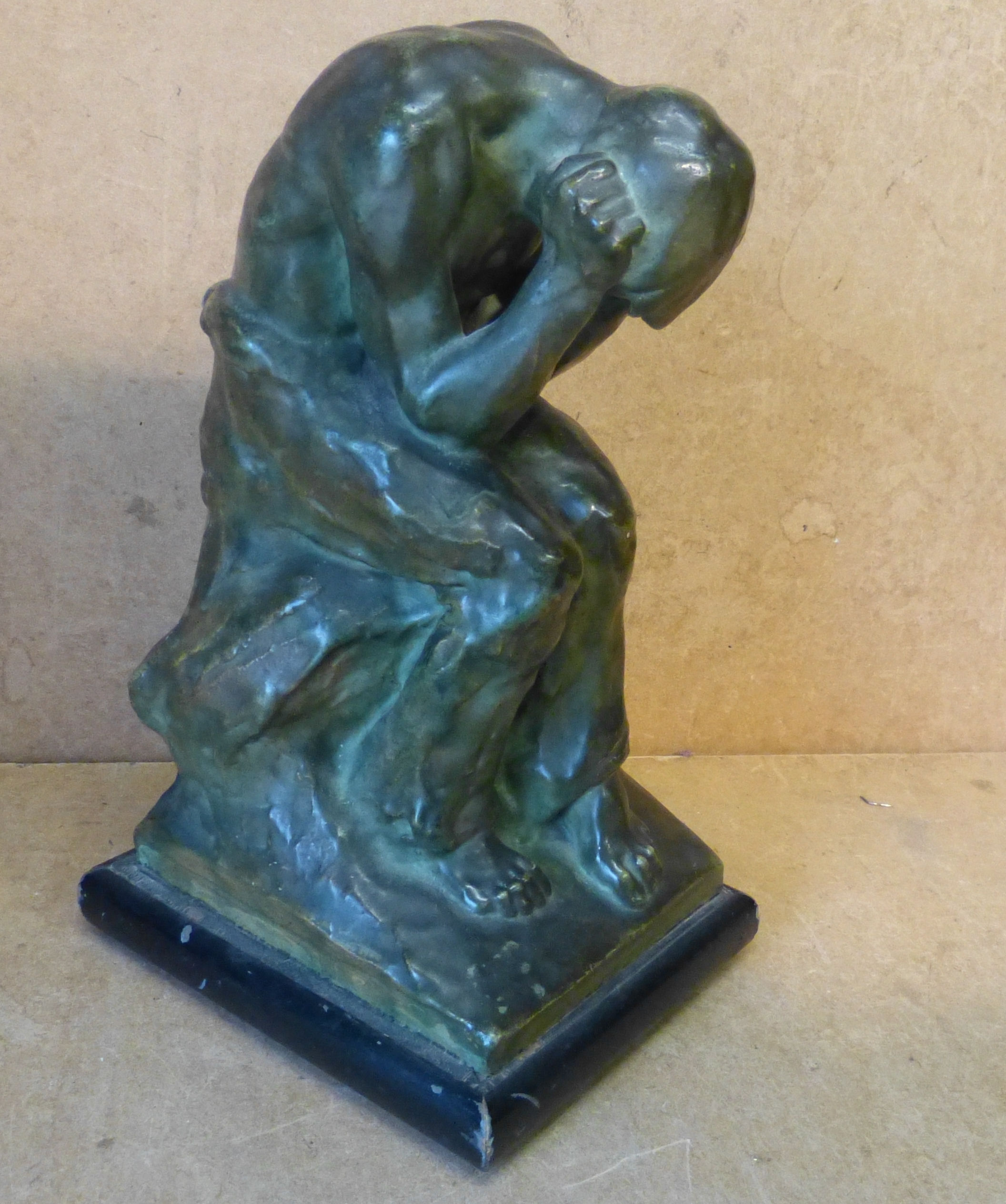 L Zorn Glazed Earthenware Figure of a seated gentleman holding head in hands on rectangular base