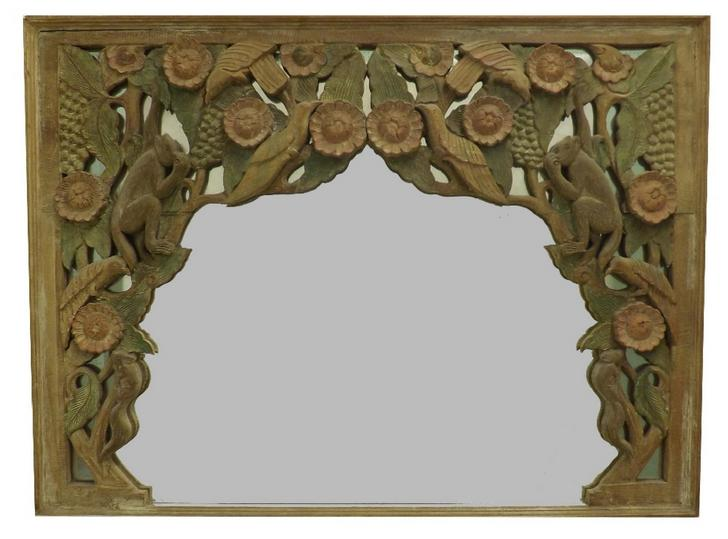 Interesting Eastern hardwood overmantel mirror, the mirror plate with carved wooden overlay of wildlife in trees and flowers