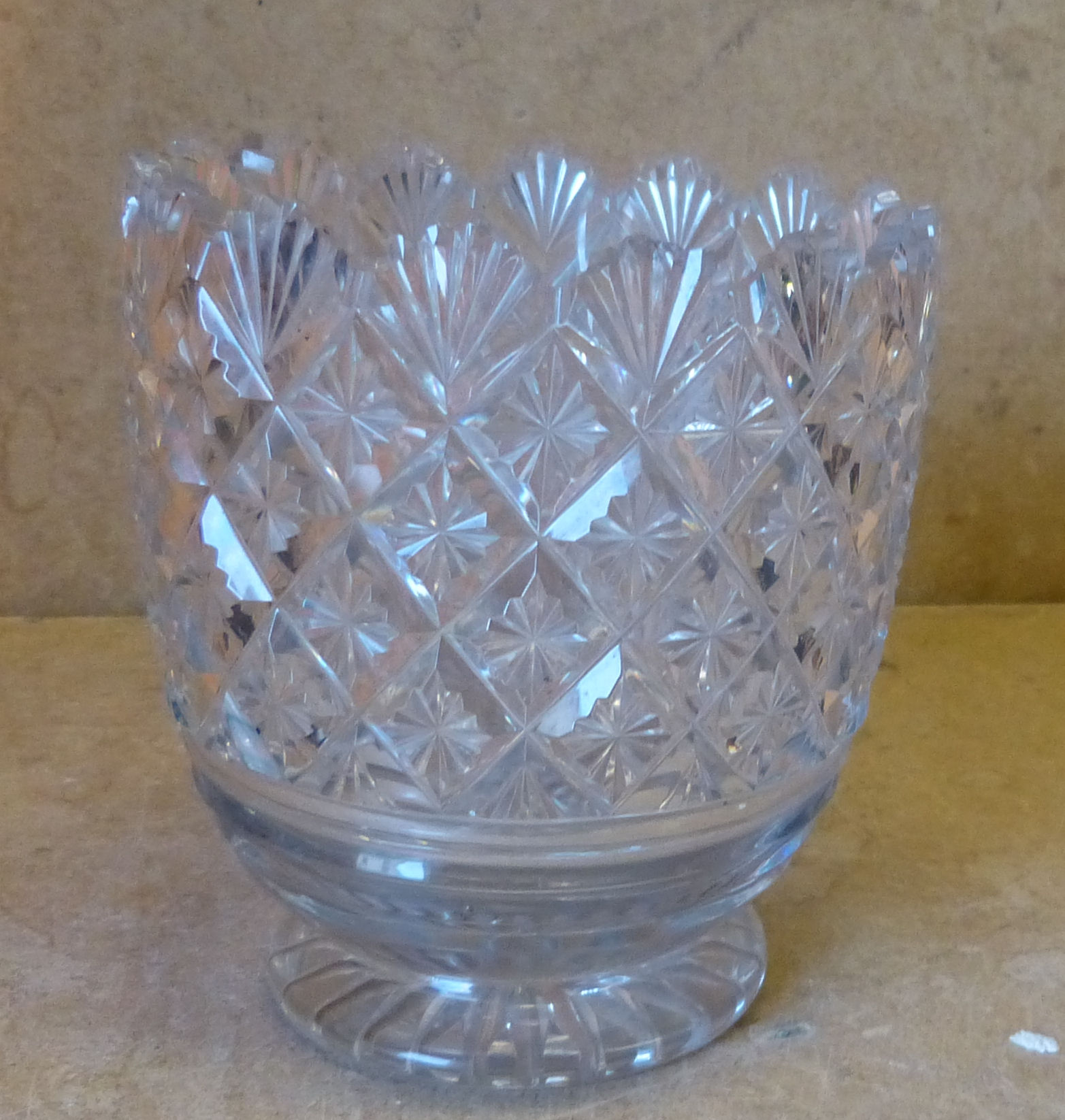 A Georgian Cut Glass Vase having crinkled rim with all over star cut decoration