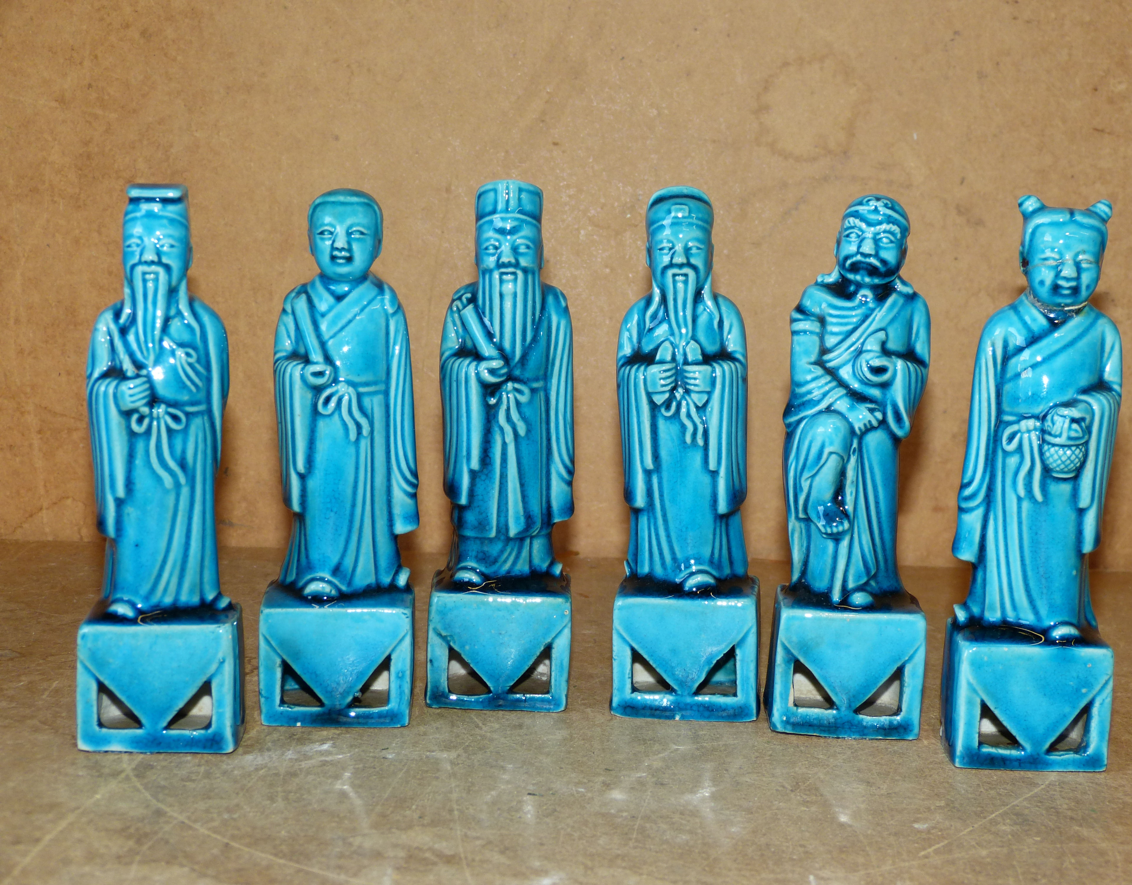 A Set of 6 Oriental China Figures on turquoise ground standing on platforms