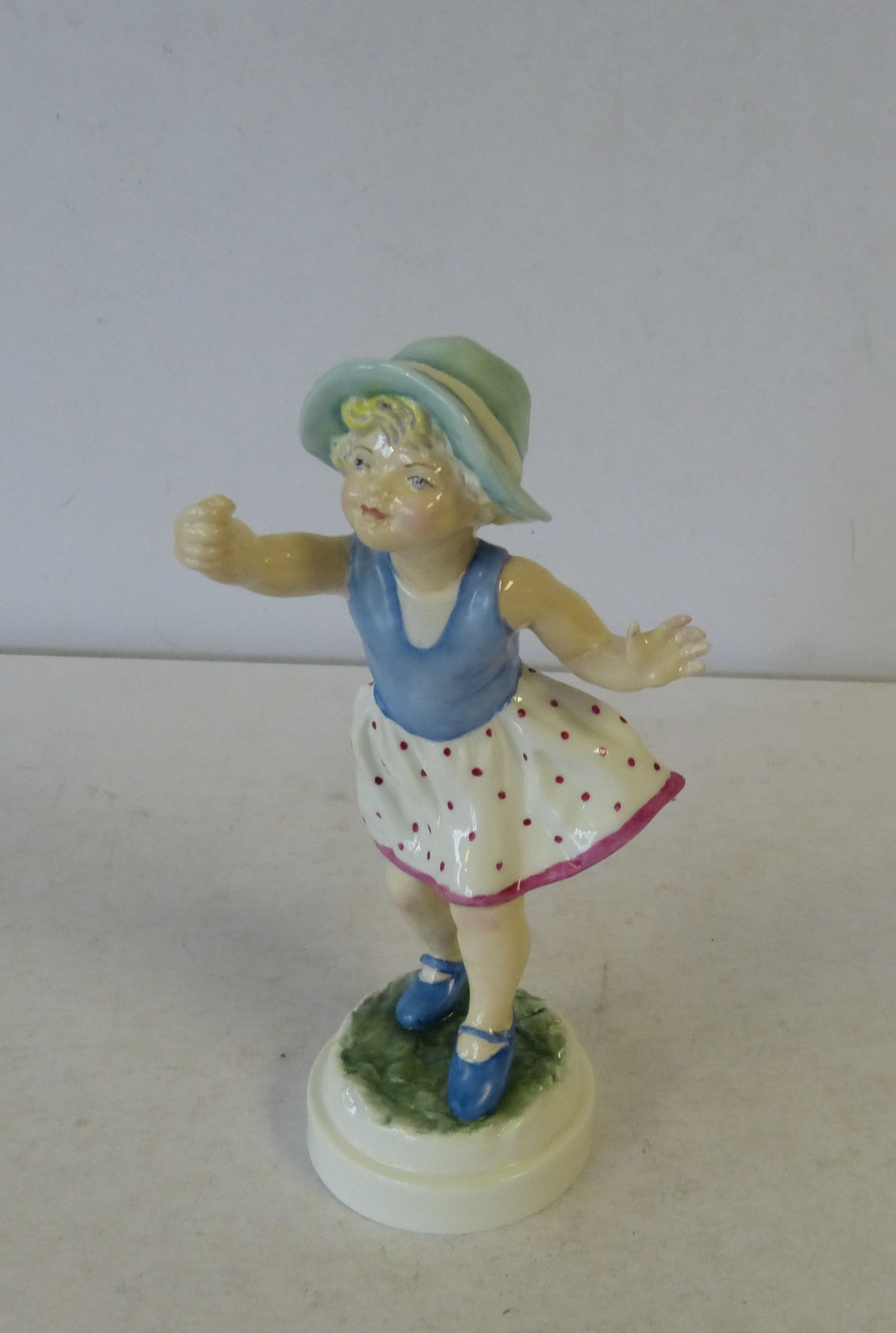 A Royal Worcester Figurine ``Sunday`s Child`` on round base (umbrella missing)