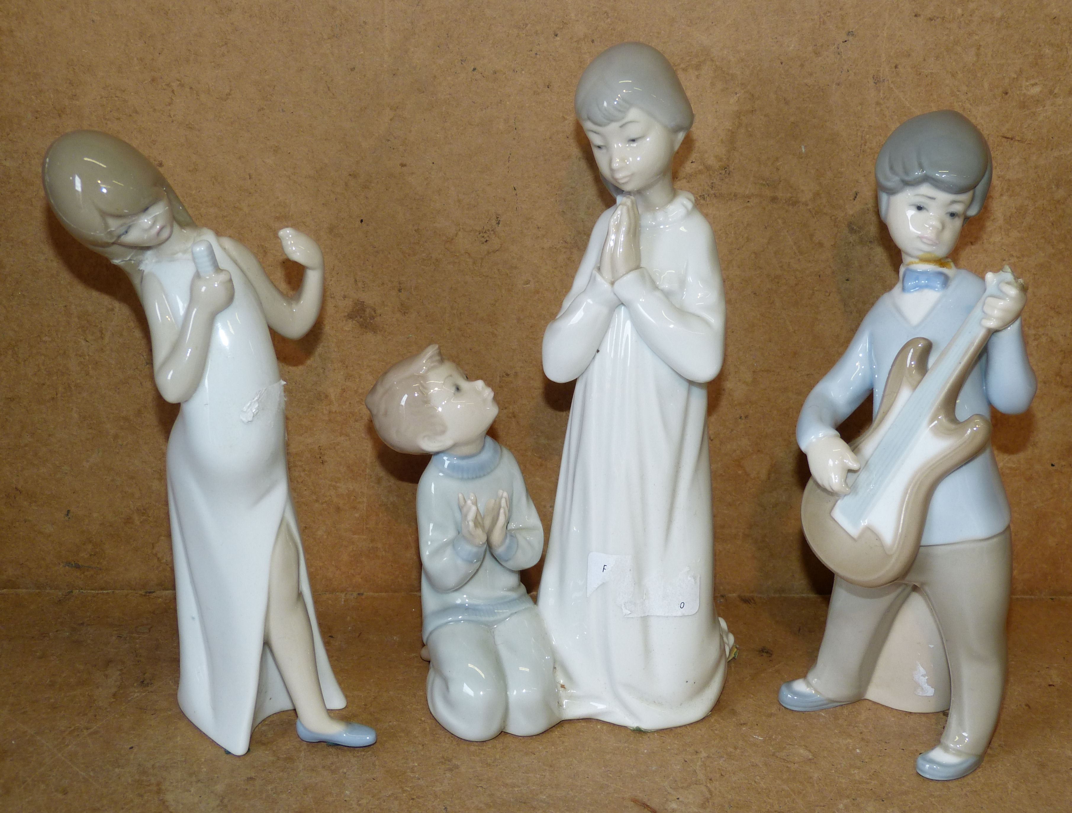 A Lladro Group of 2 children playing and 2 other Lladro figures of a singer and boy playing guitar(all a/f)