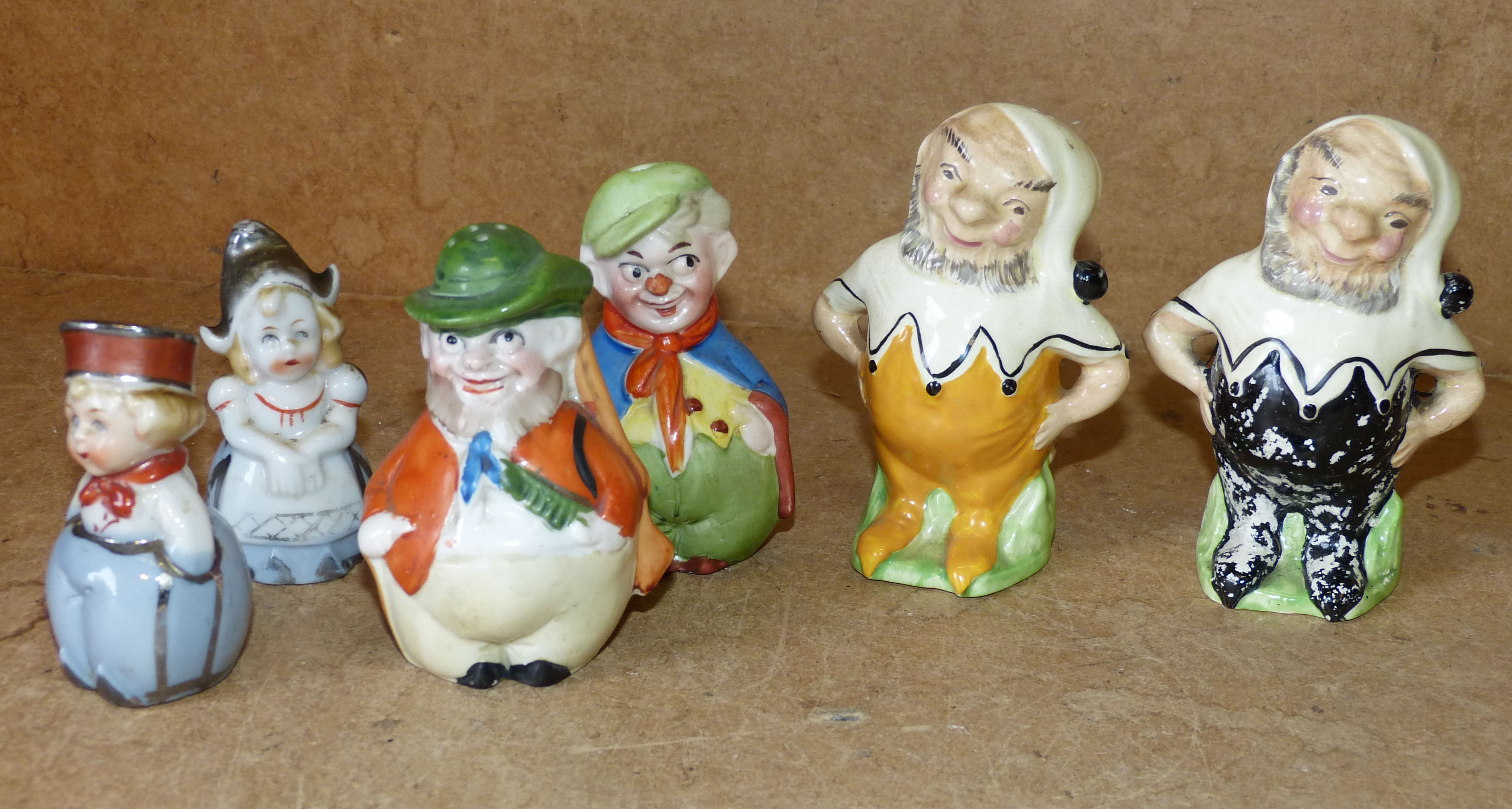 A Pair of China Condiments in form of dwarfs also 4 other similar china condiments