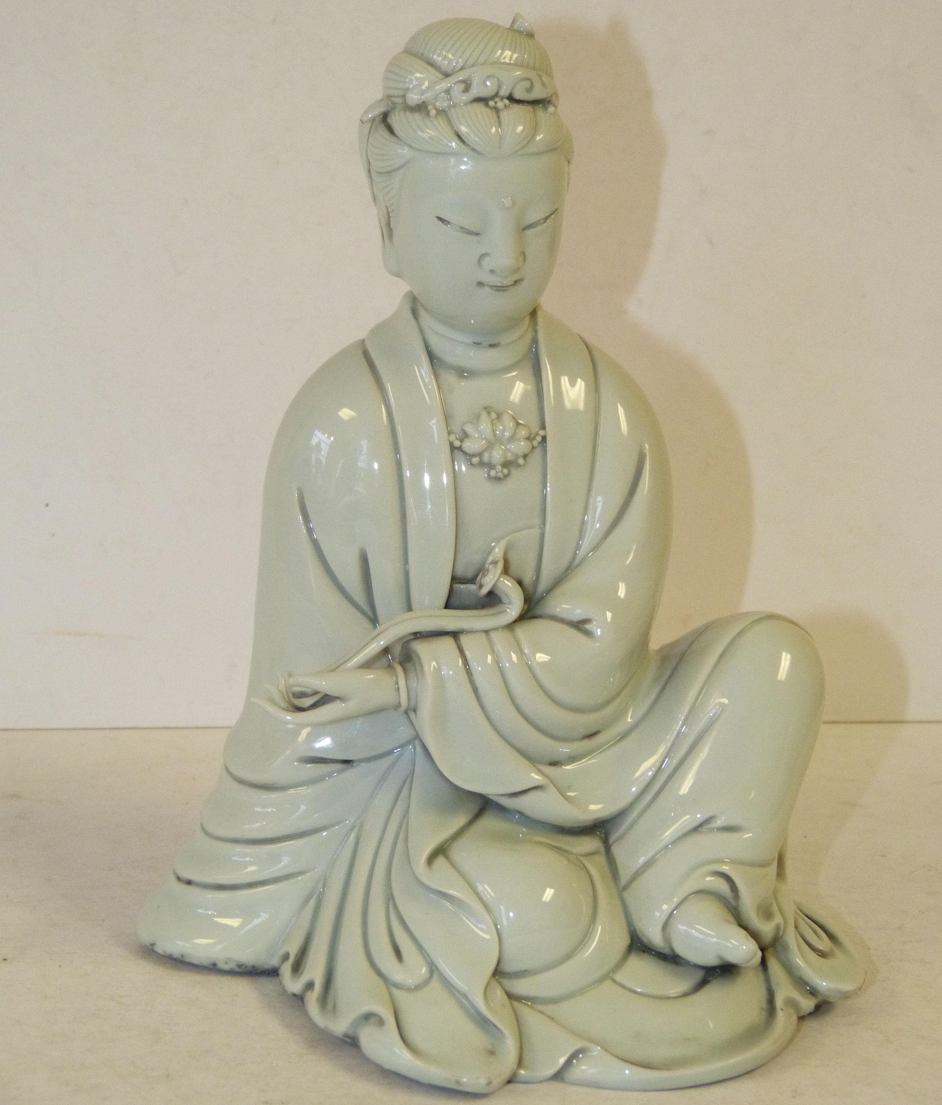 An Oriental Cream Seated Goddess holding a sceptre