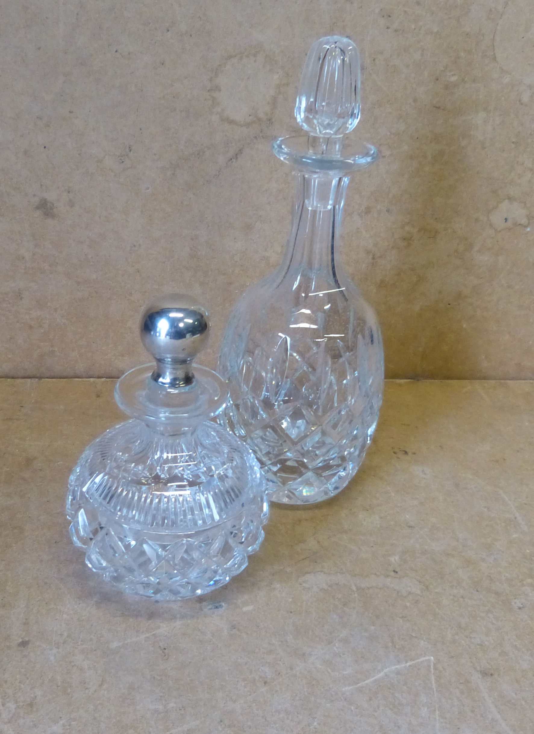 A Cut Glass Bulbous Thin Neck Scent Bottle with stopper having star cut decoration