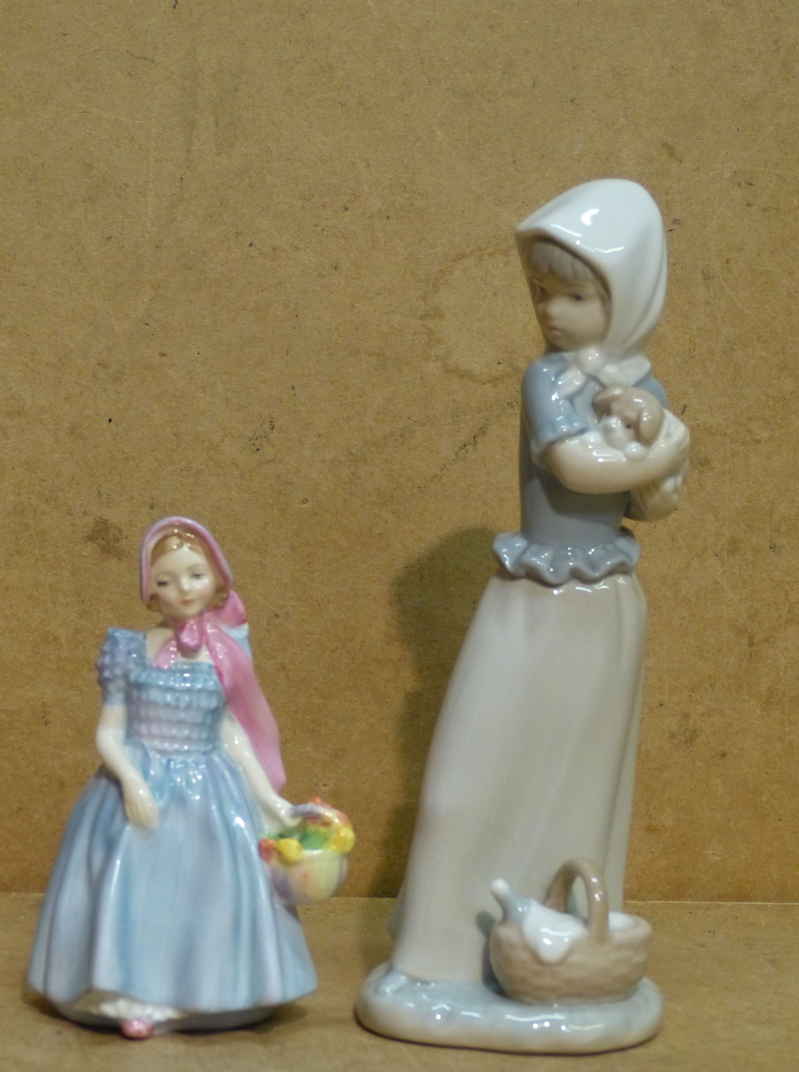 A Royal Doulton Small Figurine ``Wendy`` HN2109 also a Nao figure of a young girl holding a puppy