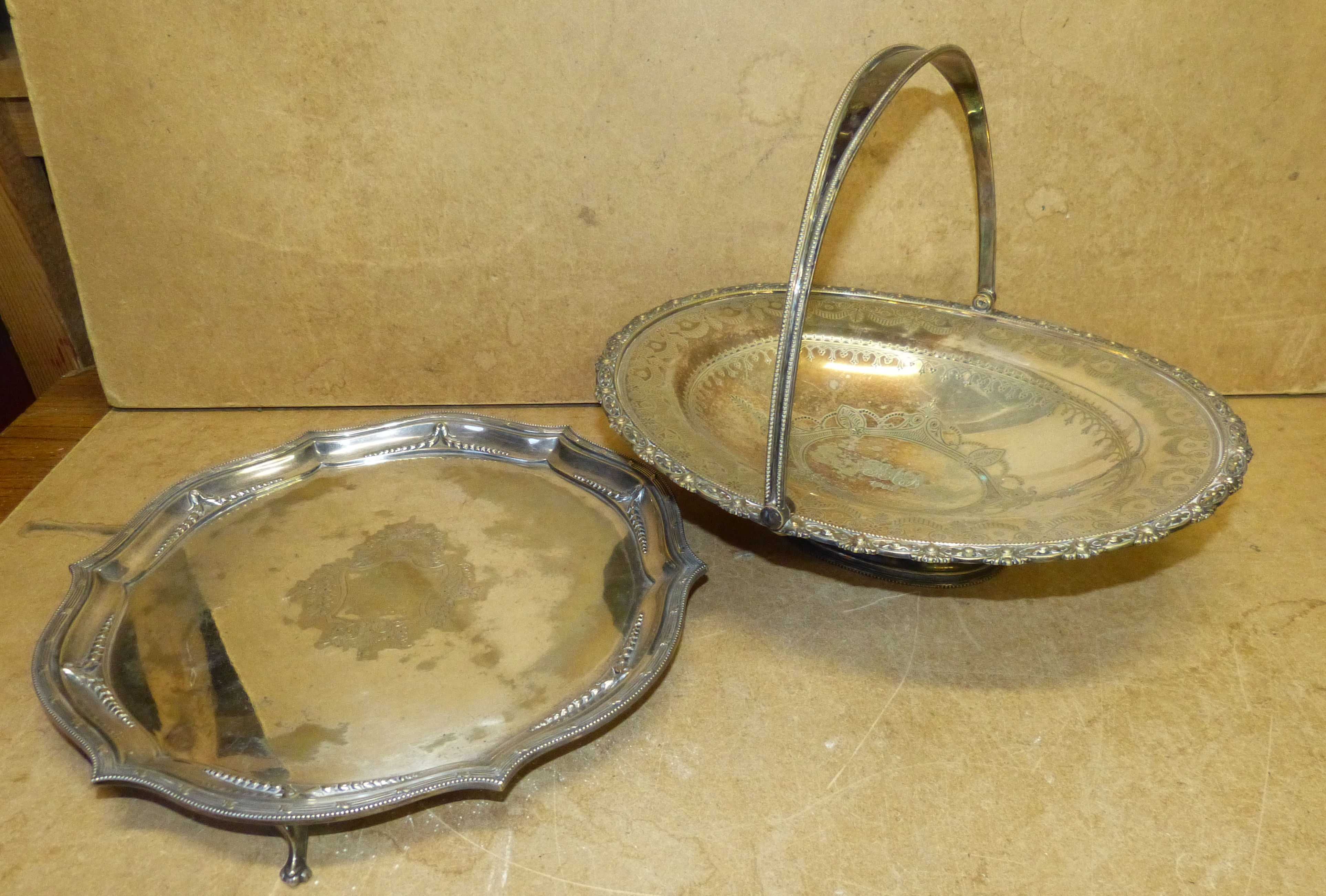A Silver Plated Rectangular Round Scalloped Salver having engraved centre on splayed feet