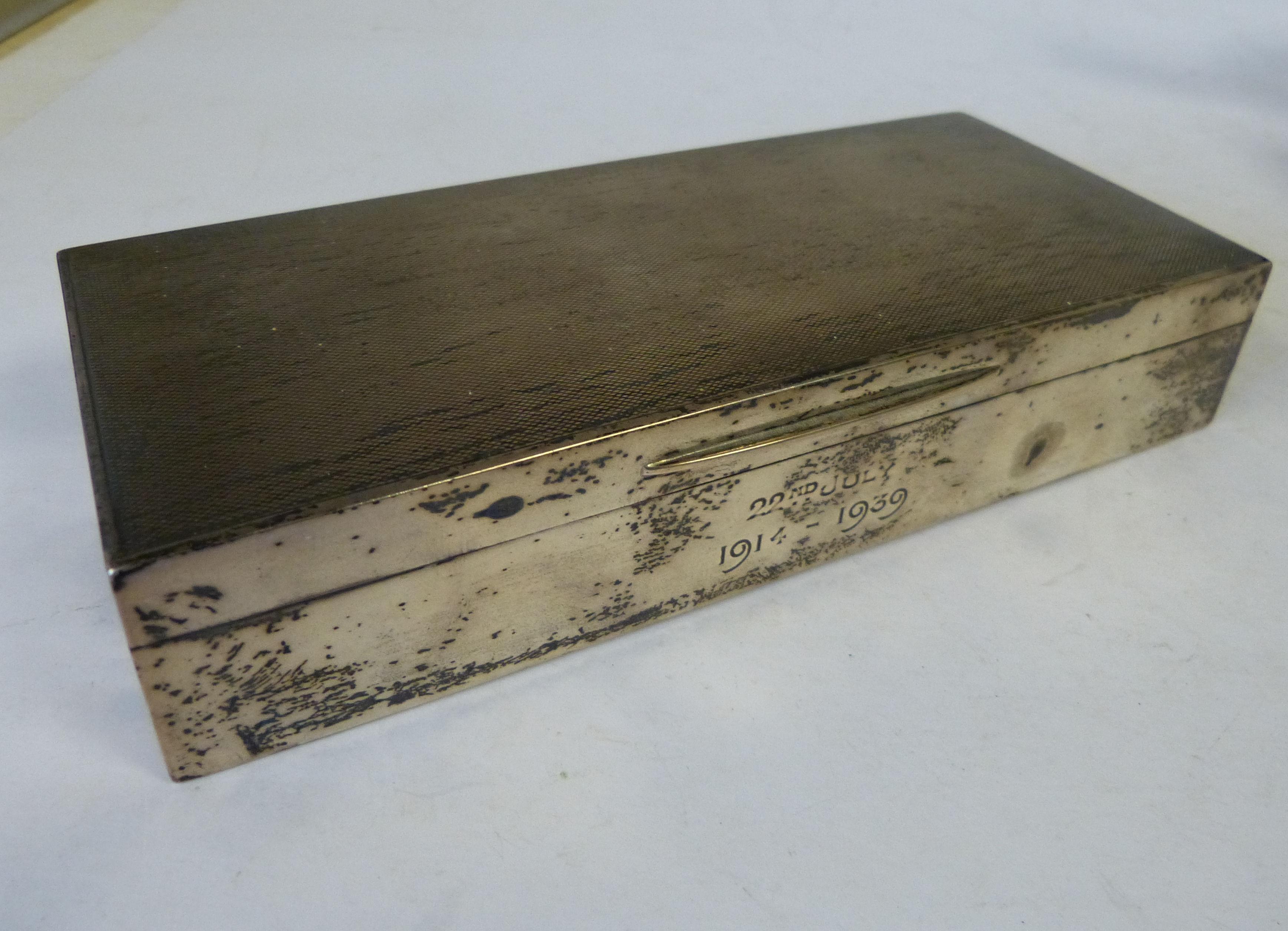 A London Silver Rectangular Cigarette Box having hinged engine turned lid
