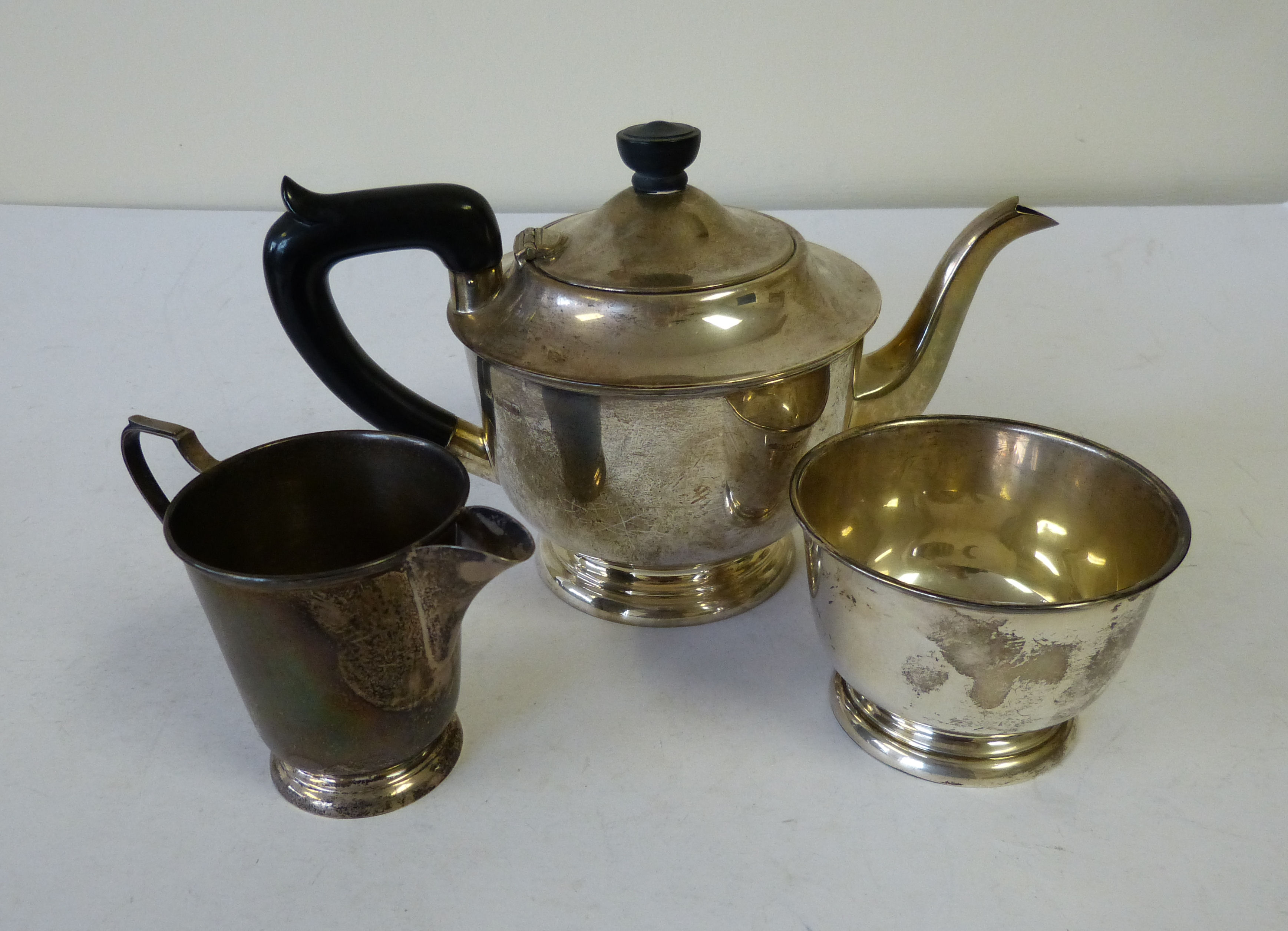 A Sheffield Silver 3-piece Bulbous Tea Service comprising teapot with ebonised handle and finial