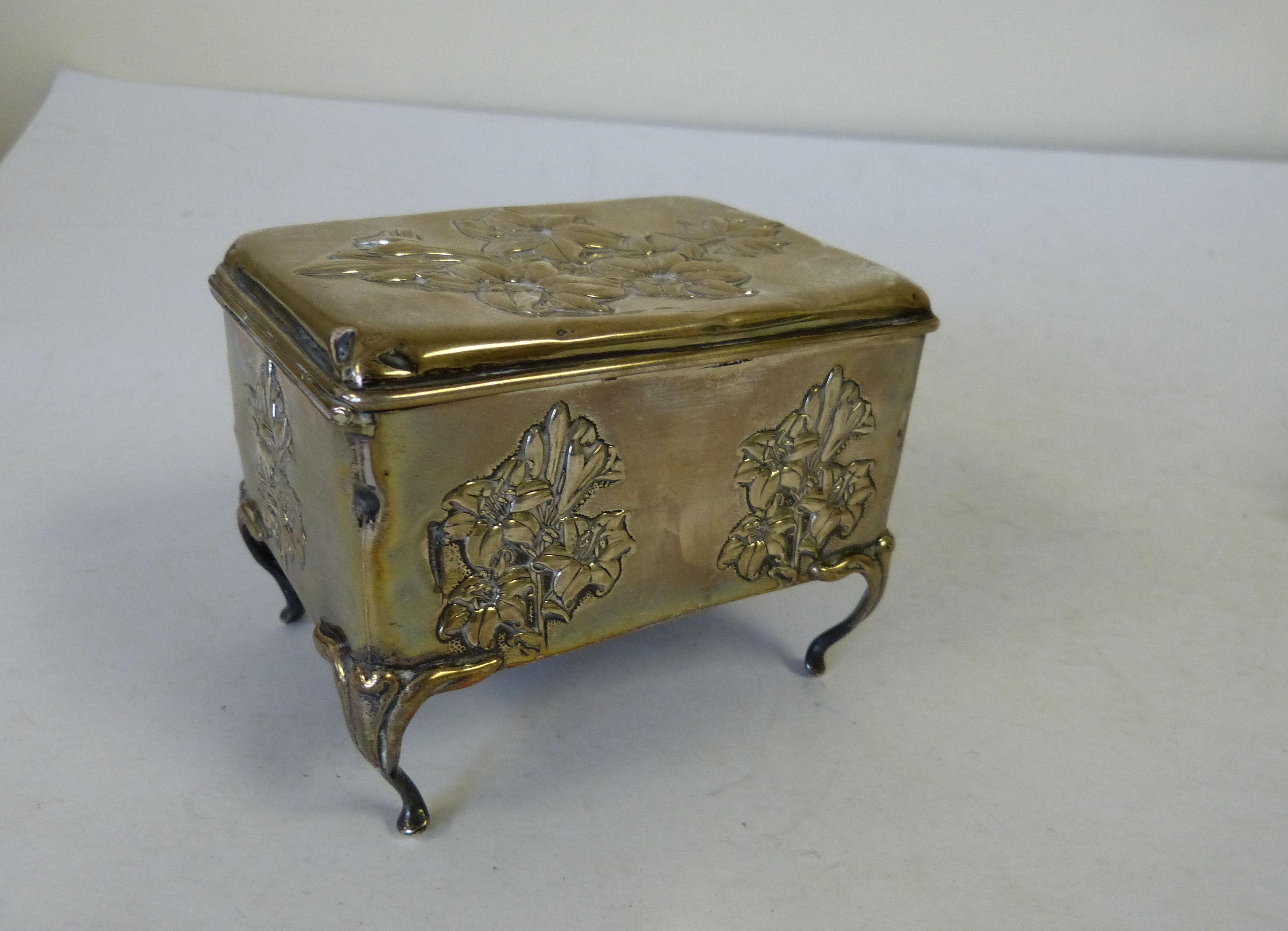 A Birmingham Silver Rectangular Trinket Box having all over embossed floral and leaf decoration