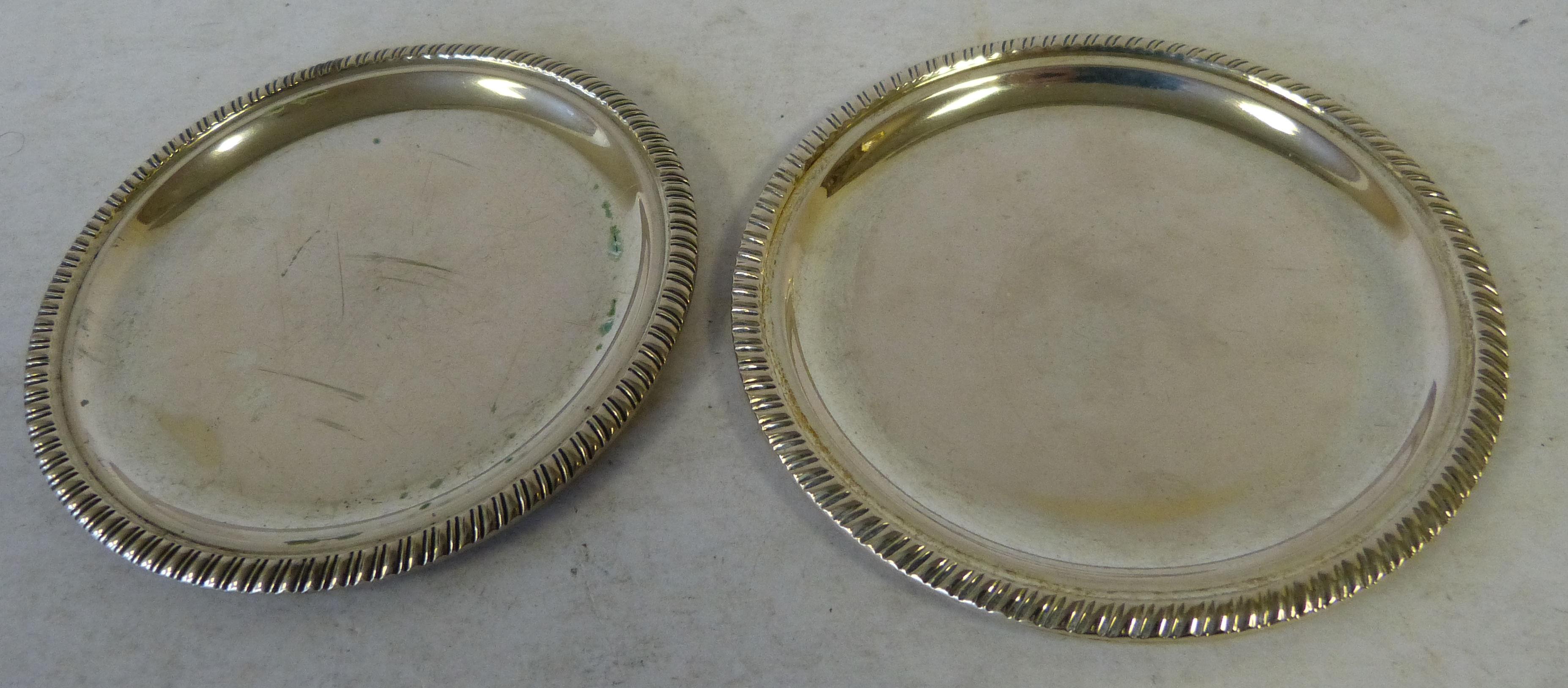 A Pair of 800 Silver Coloured Metal Coasters having gadroon rims, engraved ``Lions Club Boregomanero`` 3.2oz