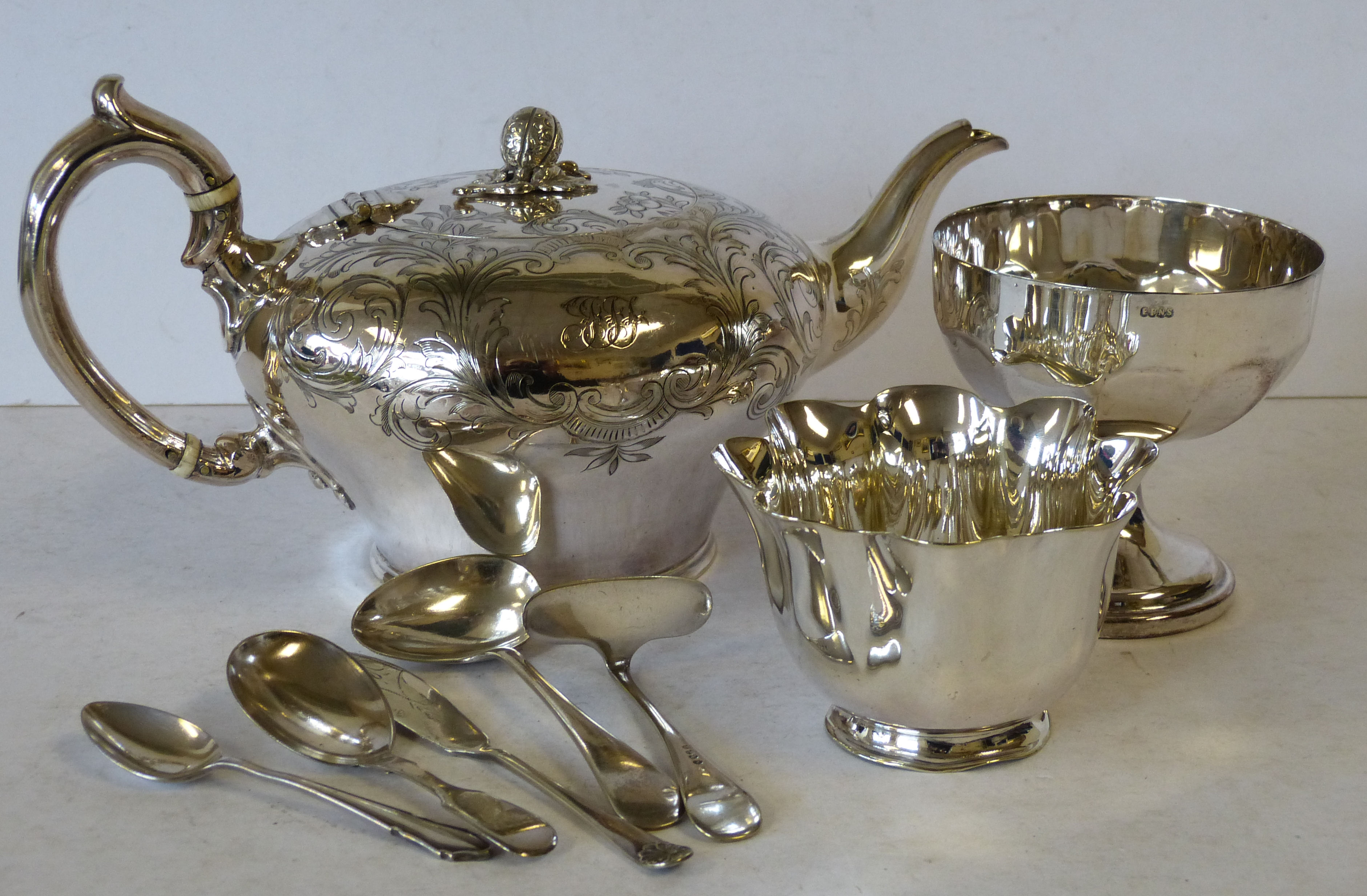 A Silver Plated Bulbous Shaped Tea Pot having engraved scroll and leaf decoration, a plated round sweetmeat dish