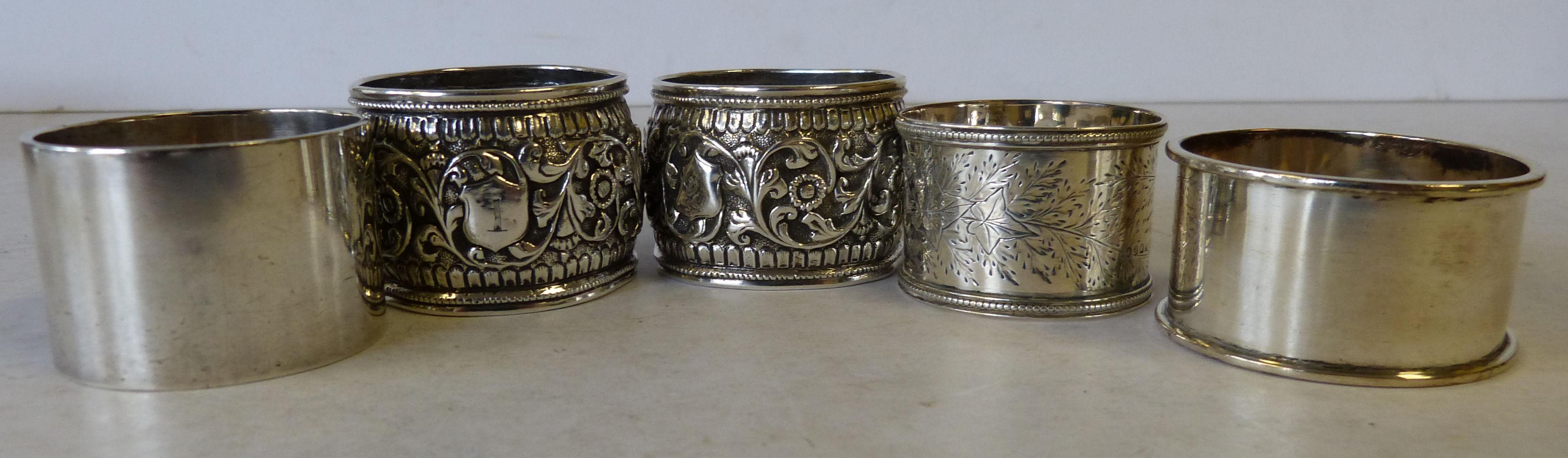 A Heavy Plain Sheffield Silver Napkin Ring, 2 other silver napkin rings and 2 other continental napkin rings