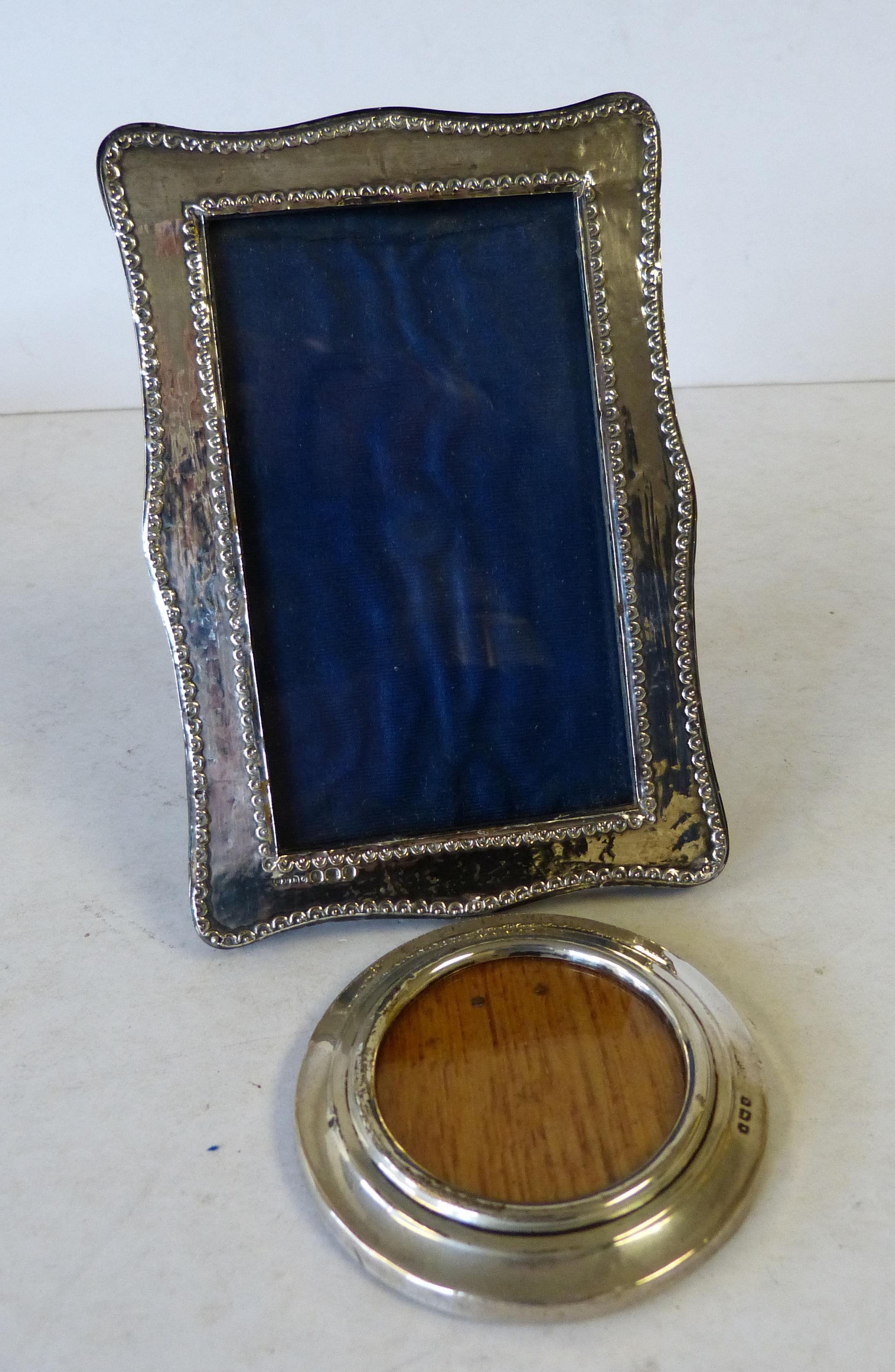 A Birmingham Silver Mounted Rectangular Scalloped Freestanding Photograph Frame