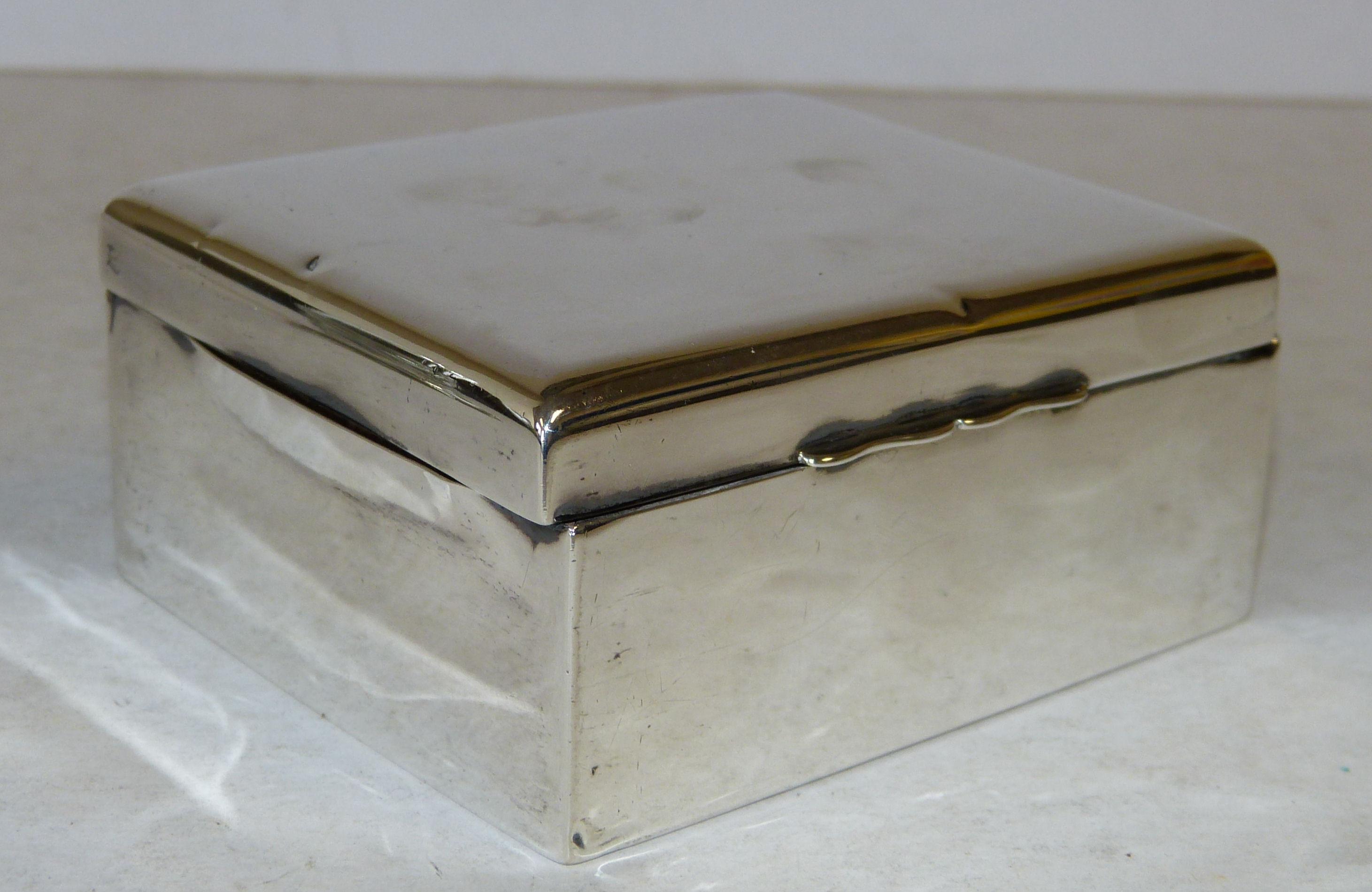 A Birmingham Plain Silver Rectangular Shaped Cigarette Box having hinged lid