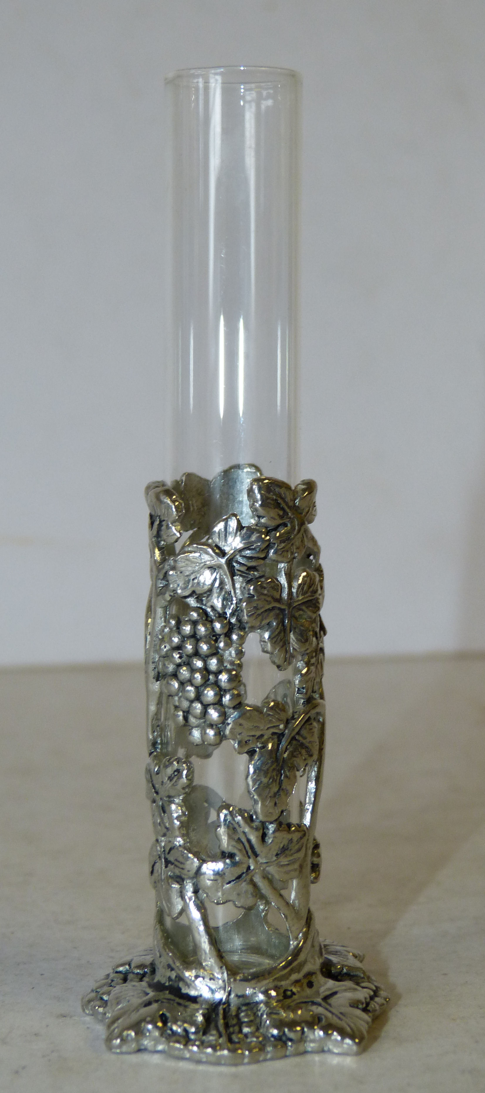 A Glass Phial Vase in silver frame having grape and vine decoration