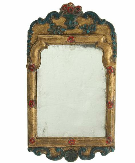 A Swedish 18th century gilded and painted Rococo mirror, carved with flowers and foliage