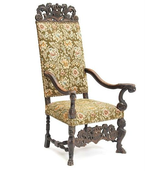 An early 18th century Danish Baroque oak armchair, richly carved with foliage and King Frederik IV's monogram