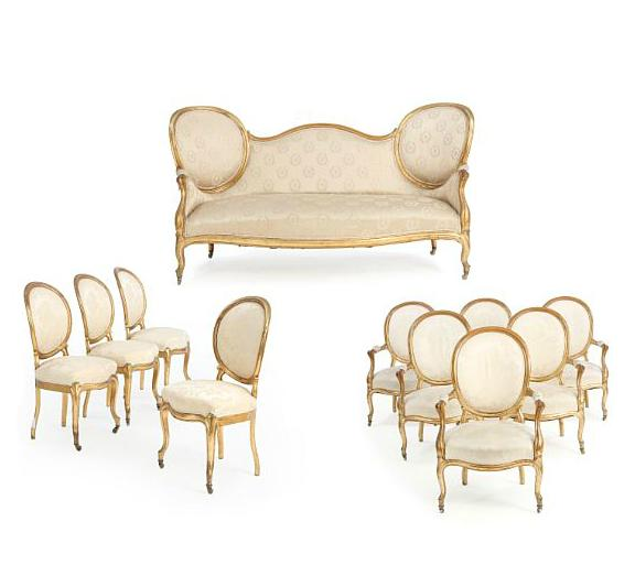A rococo style giltwood suite consisting of 10 chairs and a sofa