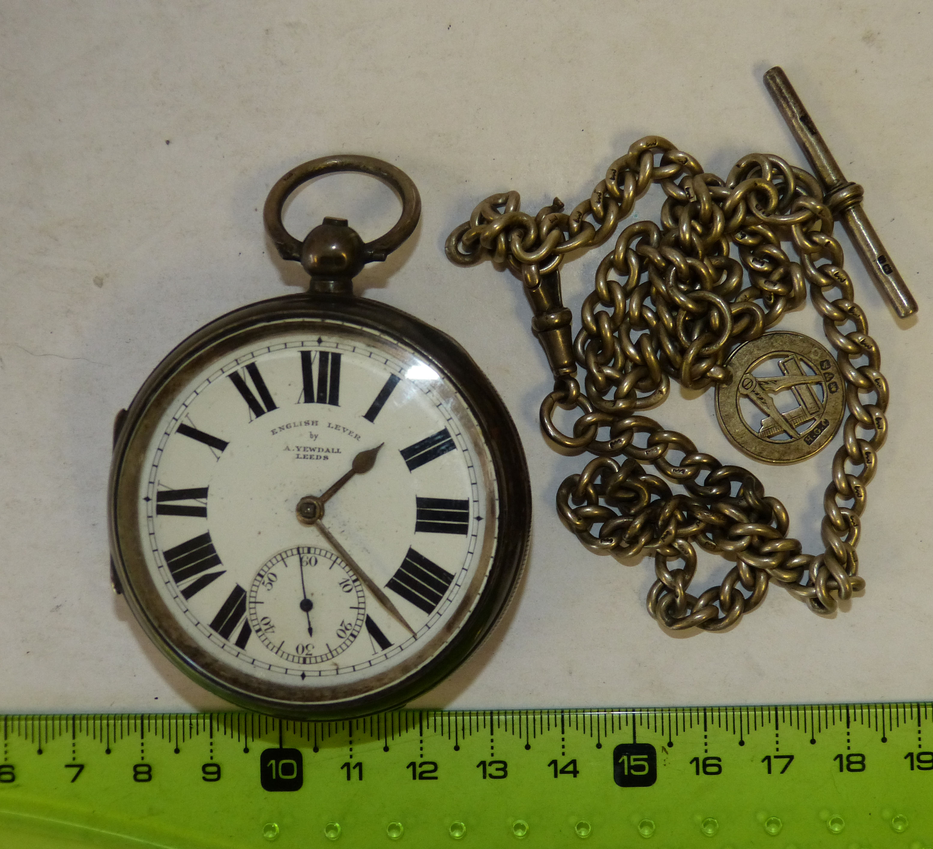 A Yewdall, Leeds Silver Open Faced Pocket Watch having white enamel dial with seconds dial and Roman numerals and with silver ch