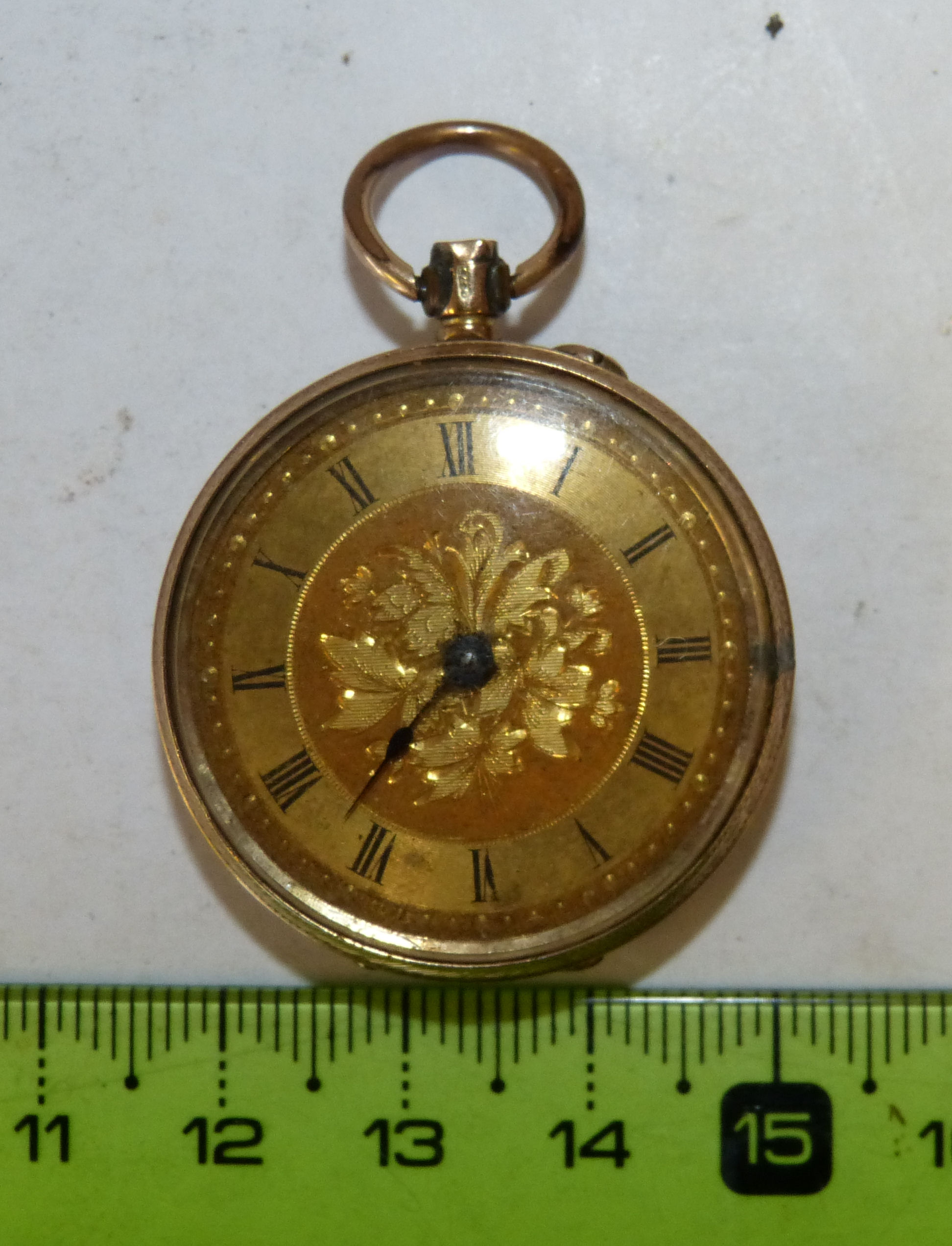 A 9ct Gold Fob Watch having gilt dial with Roman numerals, engraved back (top button missing)
