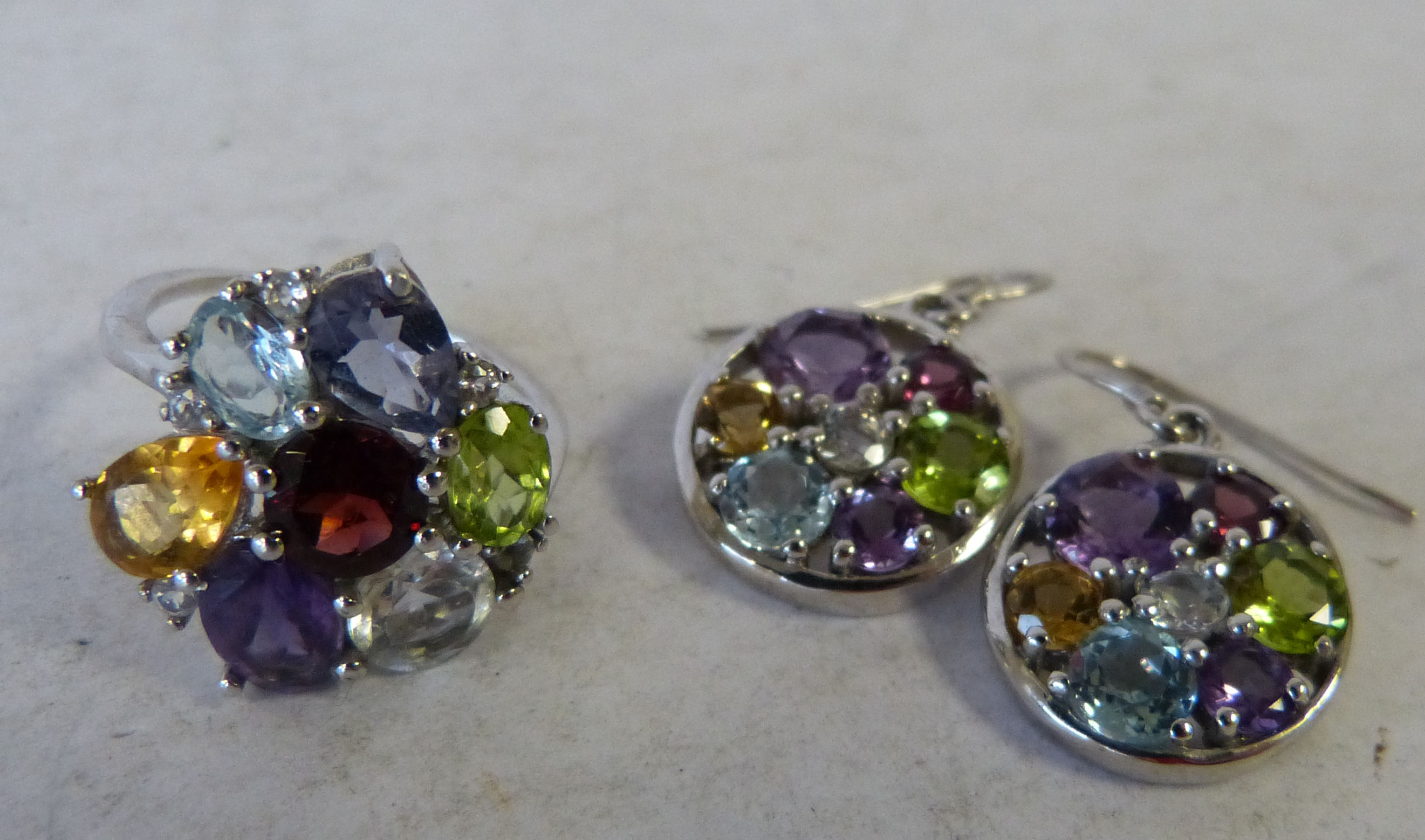 A .925 Silver Dress Ring set with coloured stones, also a pair of similar earrings (3)