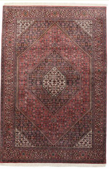 A Persian Bidjar medallion rug, embellished with Herati pattern on red base