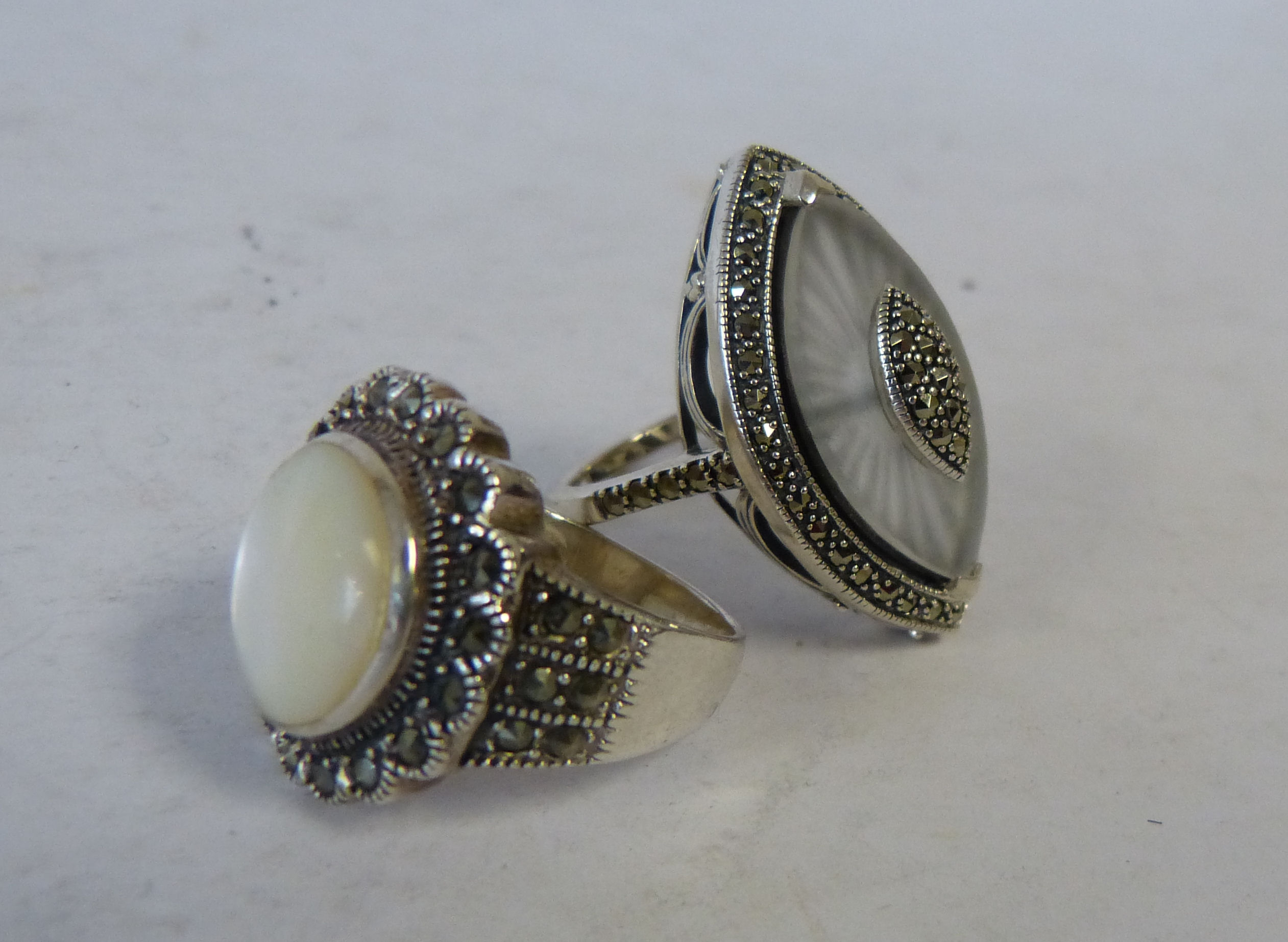 A Silver and Crystal Ring set with Marcasite, also another silver ring set with Mother of Pearl