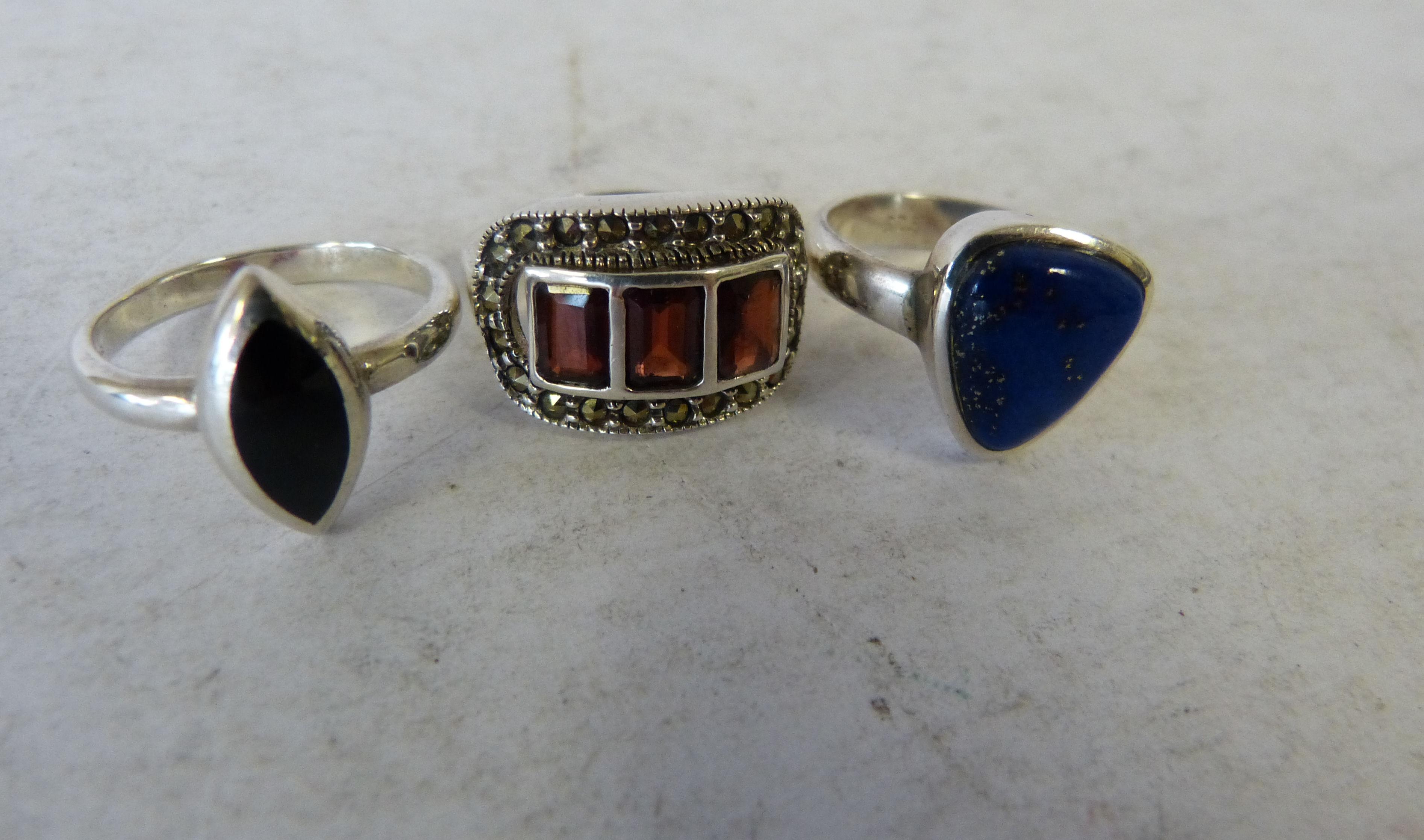 A .925 Silver Garnet & Marasite Ring, a silver and onyx ring and a silver and lapis lazuli ring