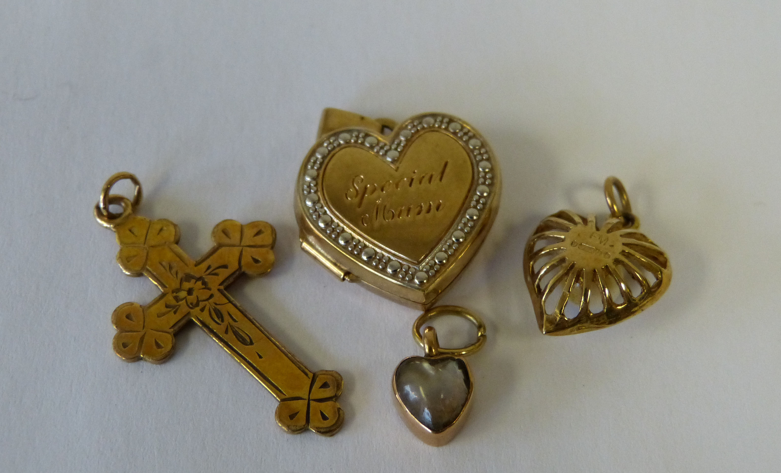A 9ct Gold Heart Shape Locket, a 9ct gold heart shape pendant inset with pearl