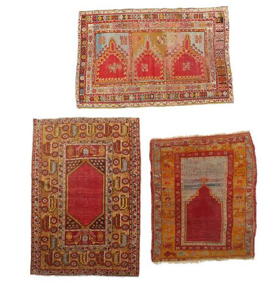 Three Turkish rugs, niche design with ornamentation, flowers and foliage on red base