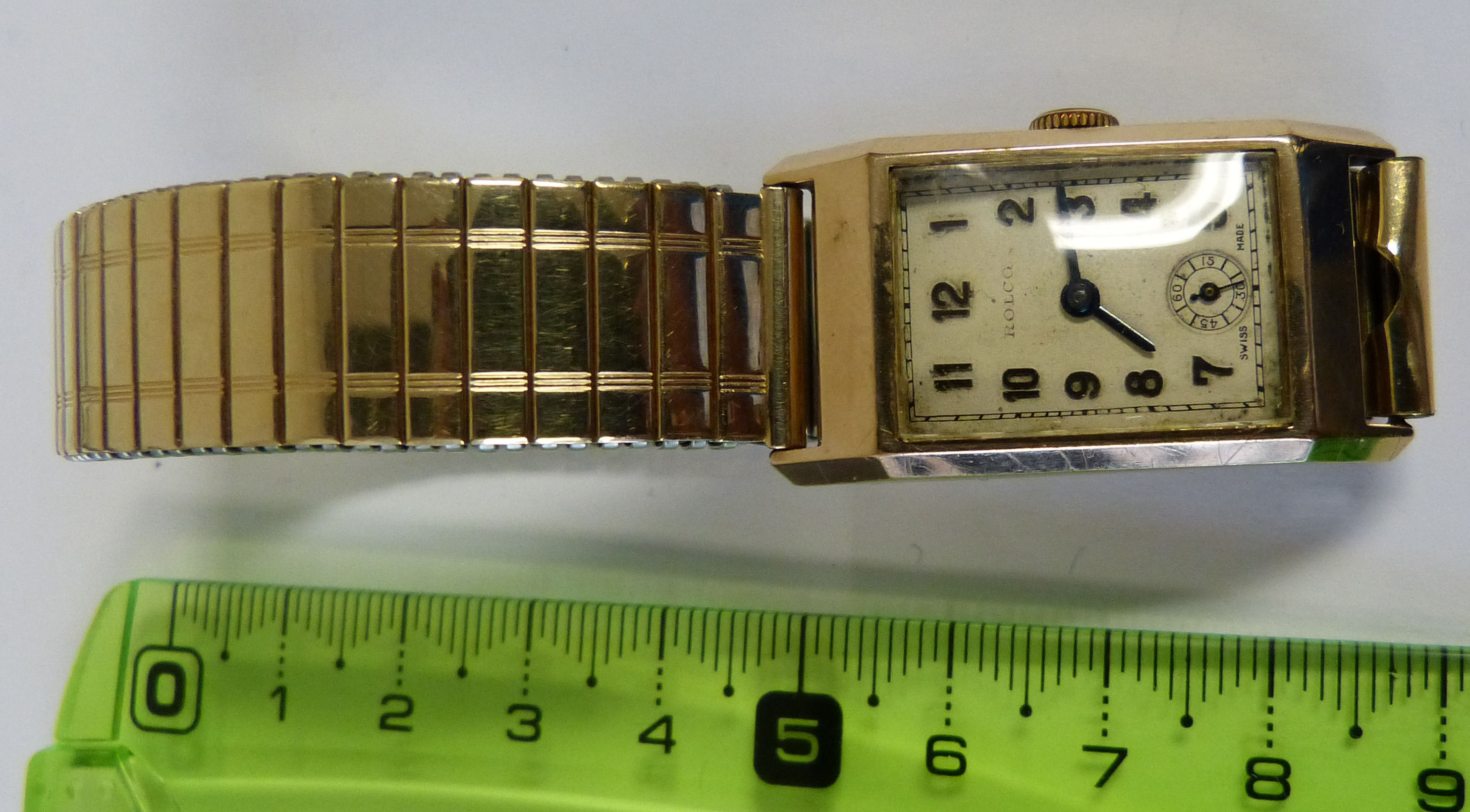 A 9ct Gold Gentlemen`s Rolco Rectangular Shaped Wristwatch with seconds dial and Arabic numerals having expanding strap bracelet