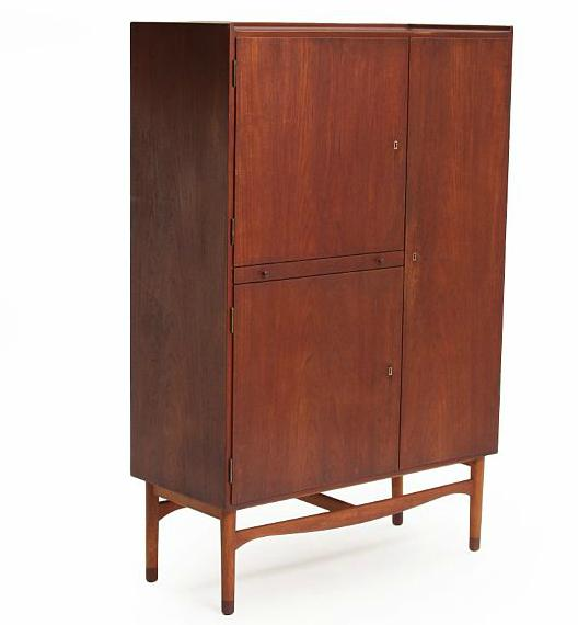 Tall teak cabinet with beech frame with teak shoes, top with raised edges. Front with three doors and one pull-out leaf