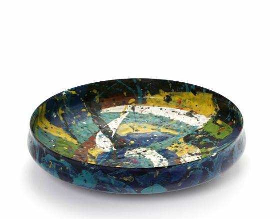 A circular metal dish decorated with polychrome enamel