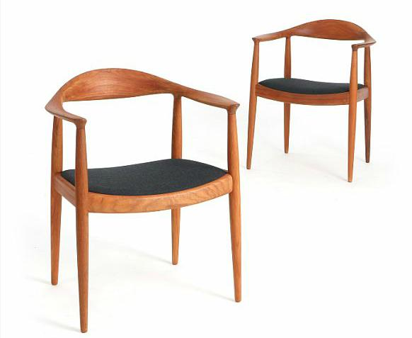 """""""The Chair"""". A pair of teak armchairs. Seats upholstered with dark grey fabric"""