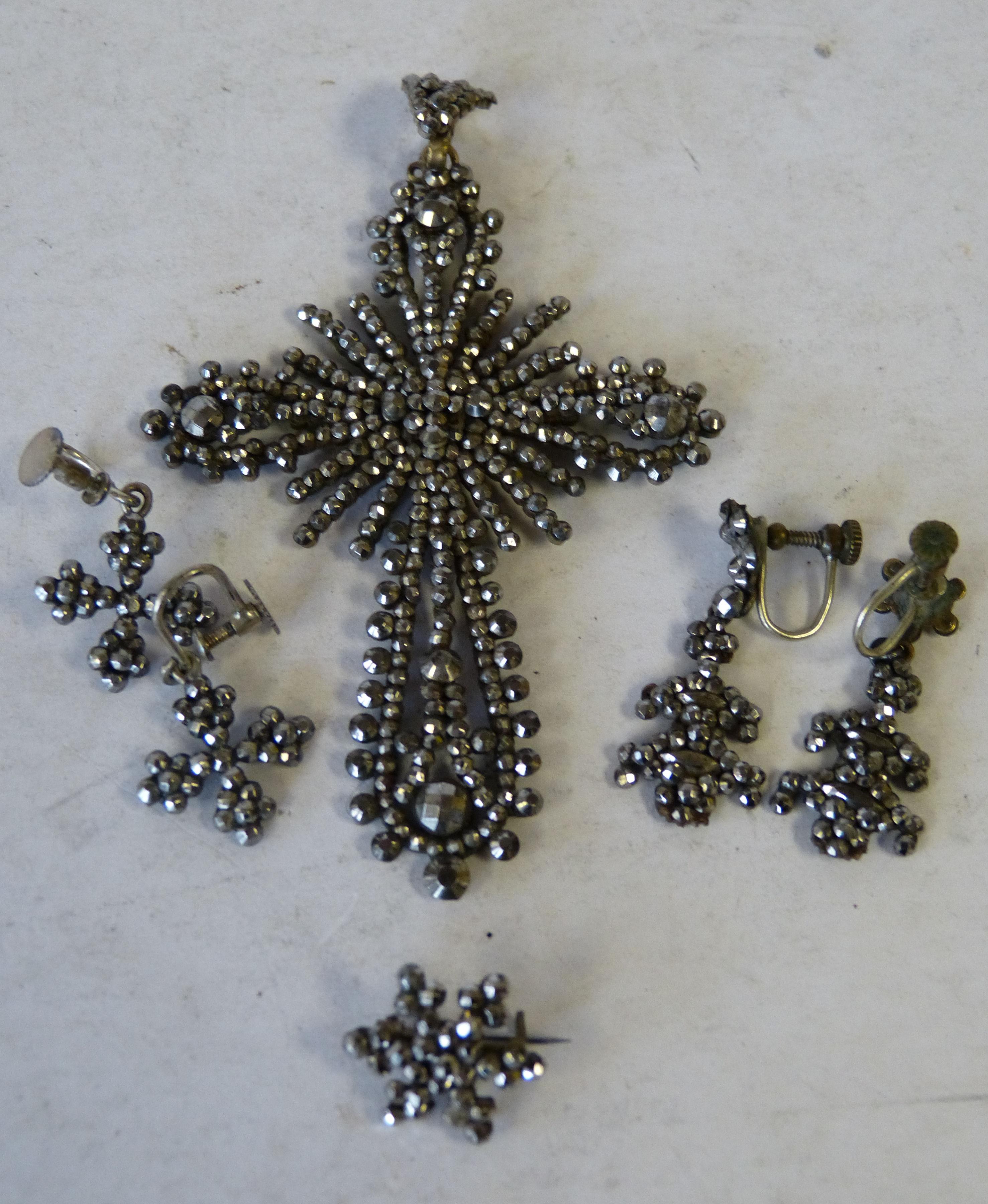 A Georgian Cut Steel Cross Pendant having pierced decoration