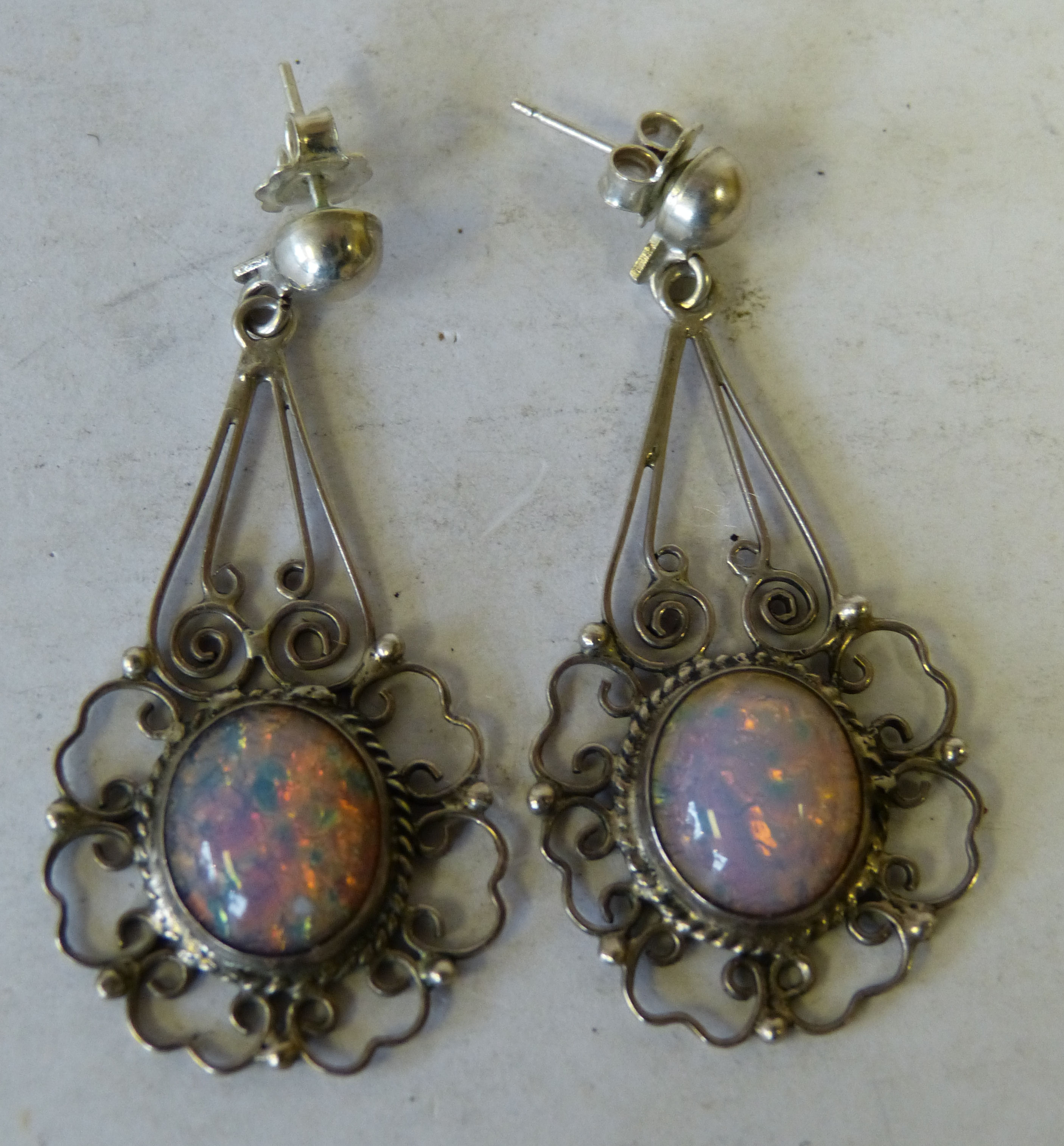 A Pair of Sterling Silver Drop Earrings mounted with opals