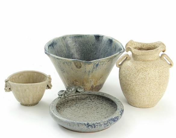 Three stoneware bowls and a vase, decorated with light speckled glazes