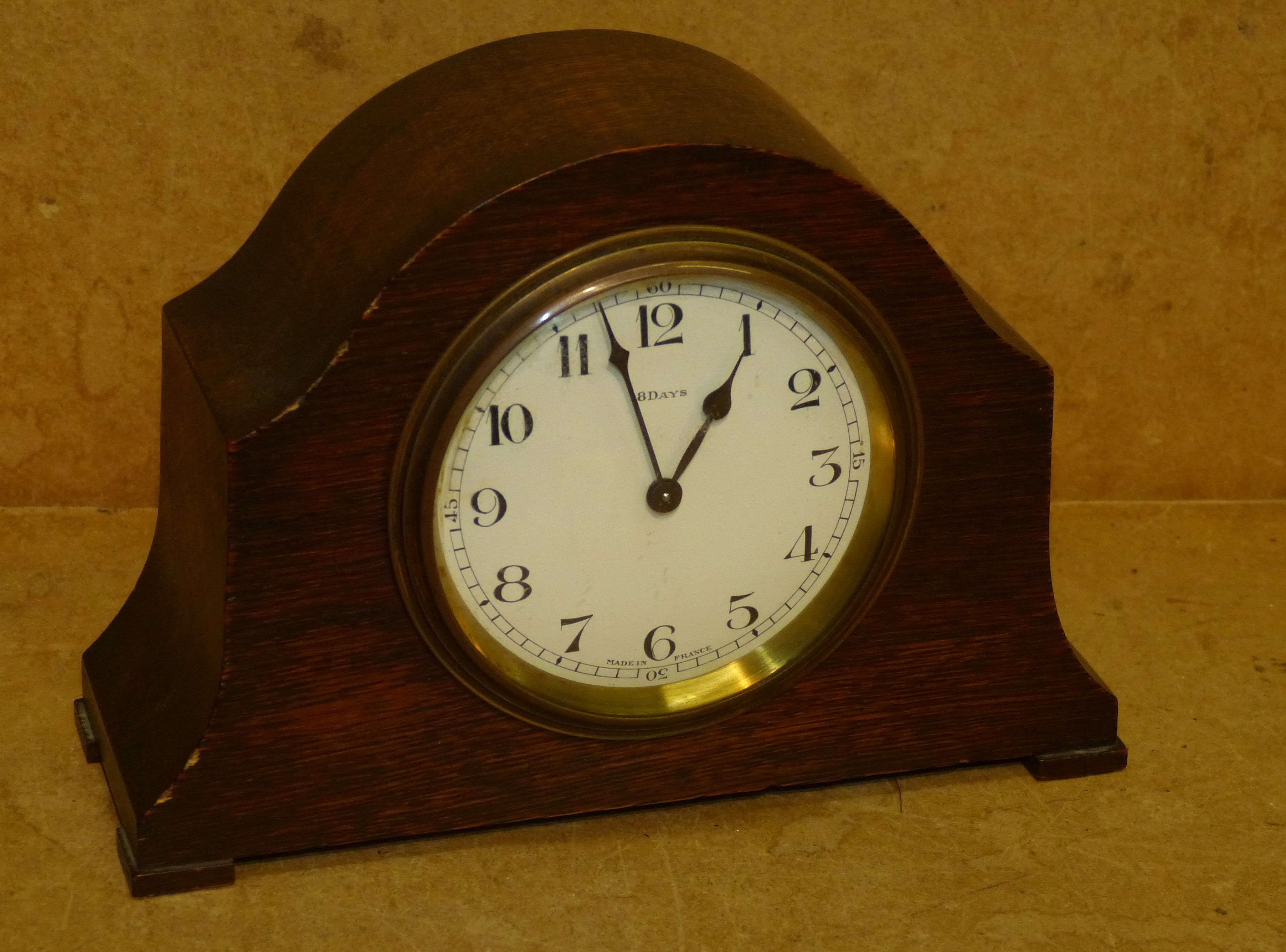 A Small 1930`s Oak Scalloped Top Time Piece having white enamel dial with Arabic numerals