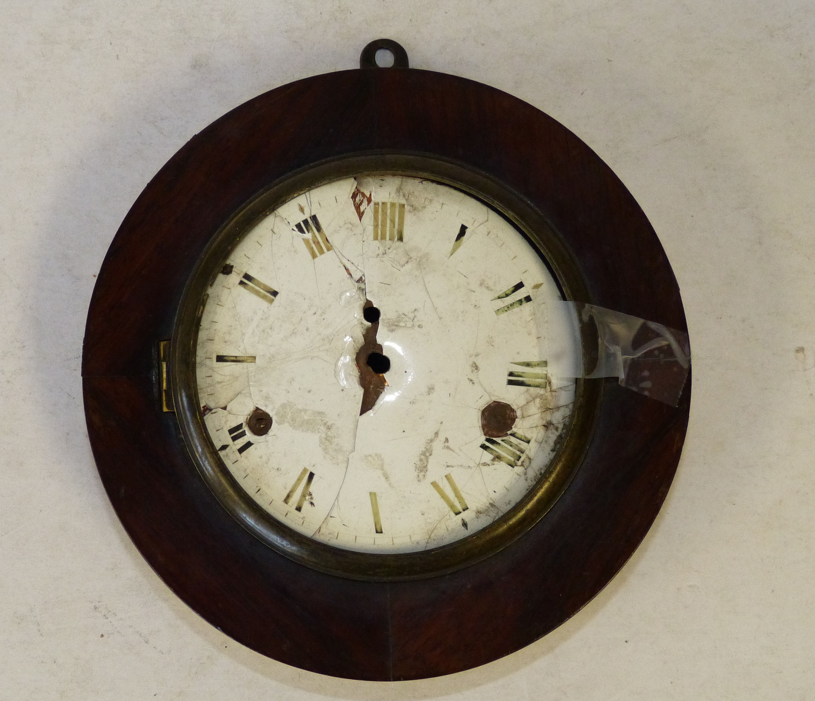 A 19th Century Mahogany ``Sudan`` Style Round Hanging Clock with white enamel dial