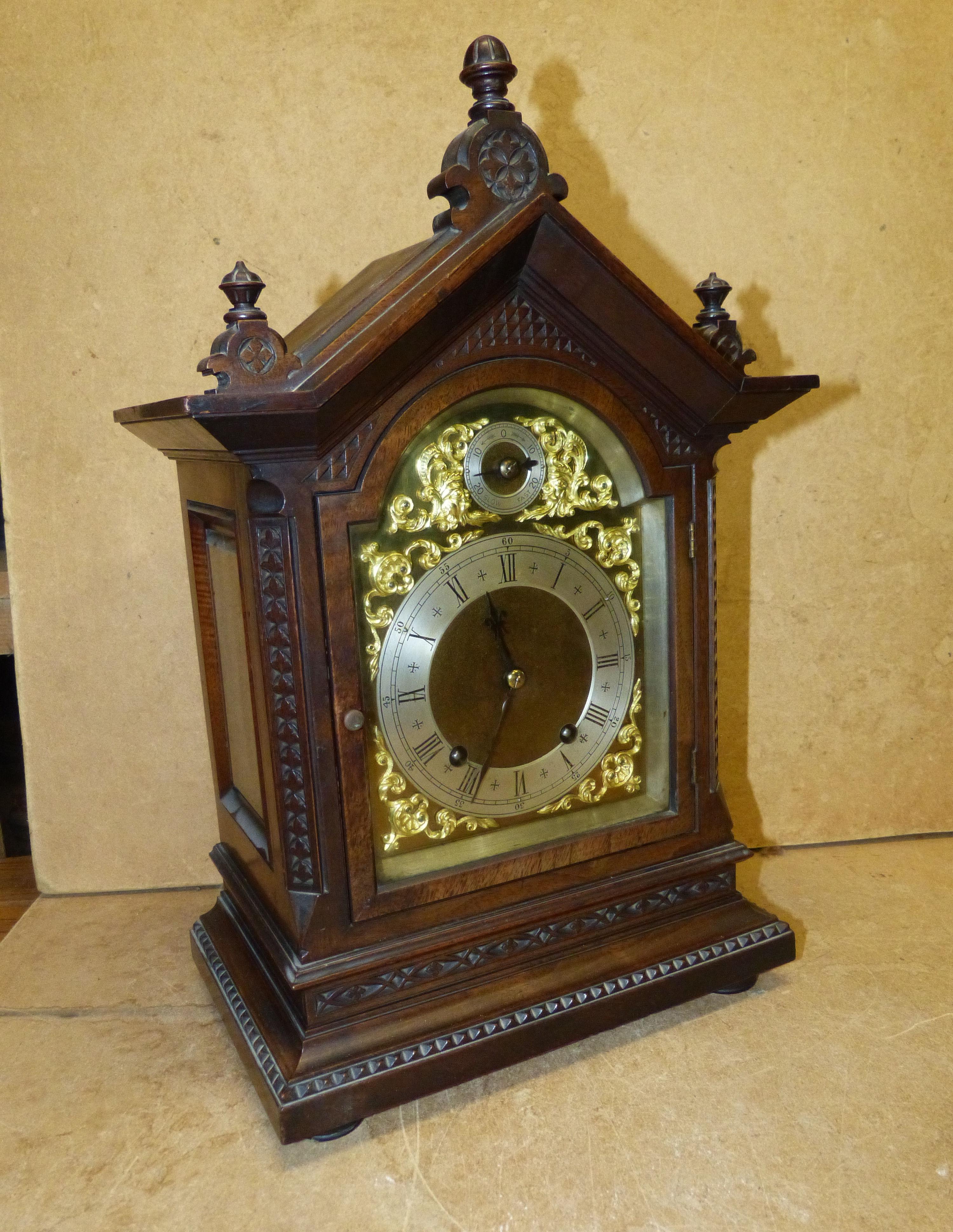 W & H 8 Day Striking Walnut Mantel Clock having turned finial