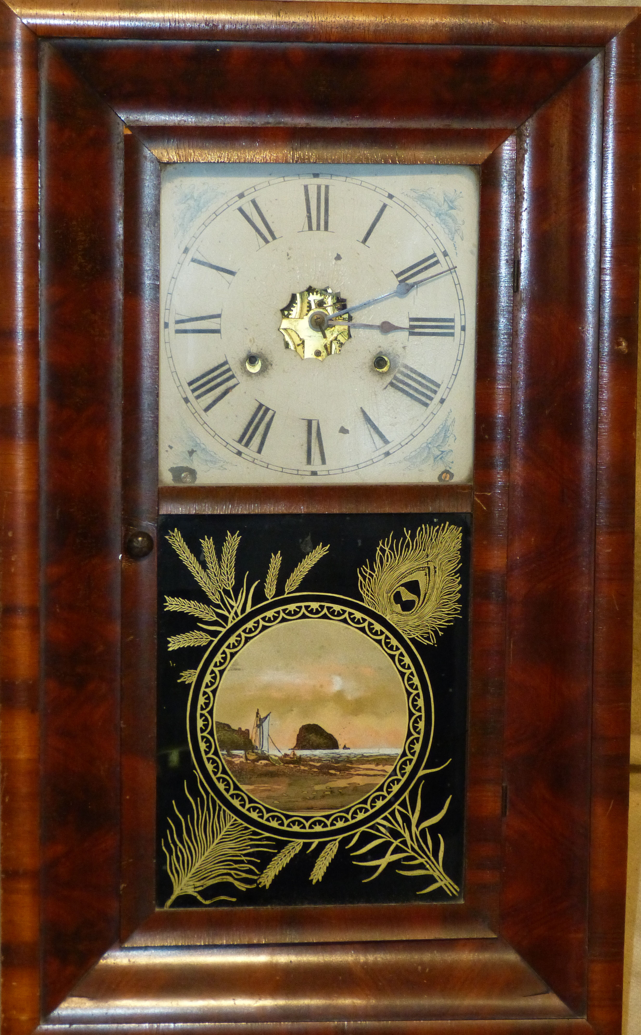 An American Hanging Wall Clock having painted door depicting seascapes