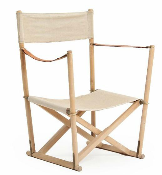 A beech folding chair, seat and back stretched with canvas, patinated leather armrests