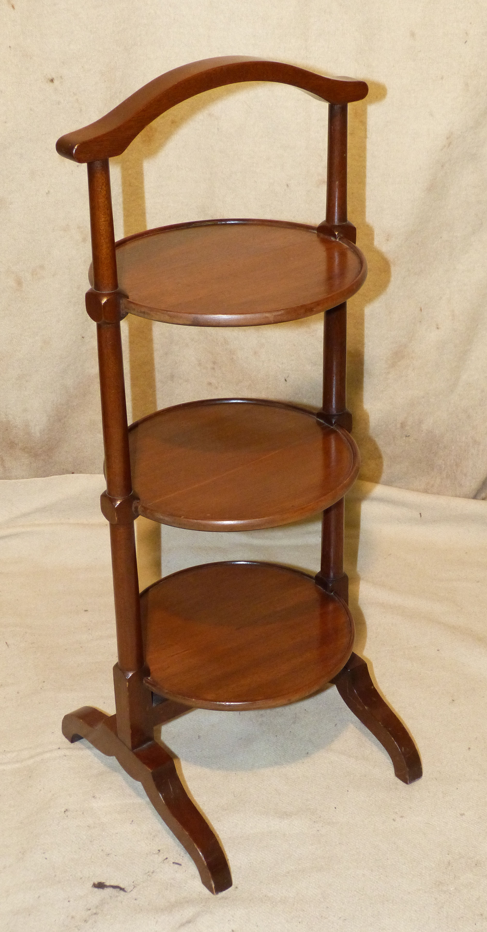 An Edwardian Mahogany 3 Tier Cake Stand having carrying handle on splayed feet